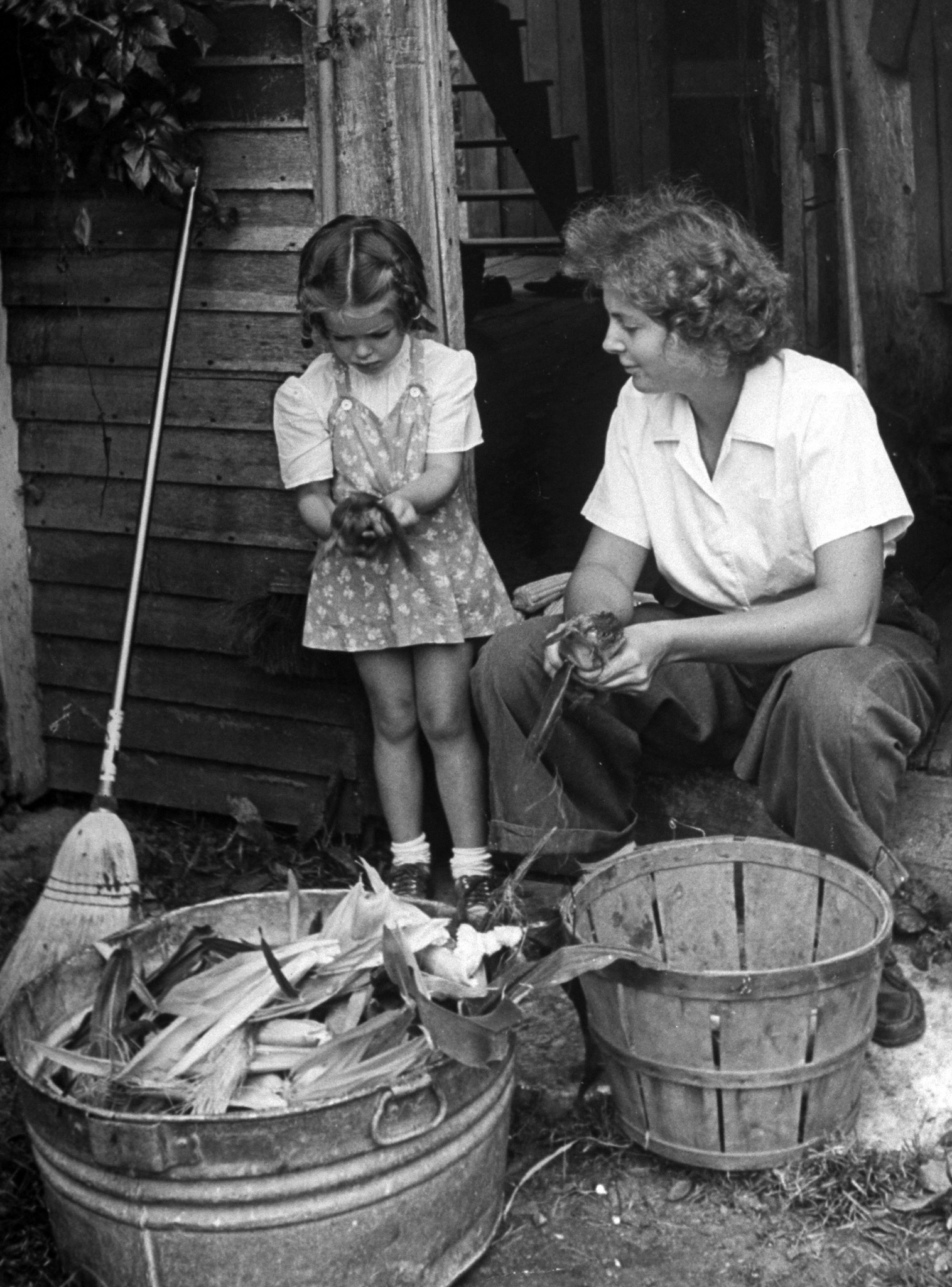 <b>Caption from LIFE.</b> Dorothy Crow, 21, husks corn with little Sandra Edson. Dorothy has a fellowship in International Relations at New York University, is writing her master's thesis.