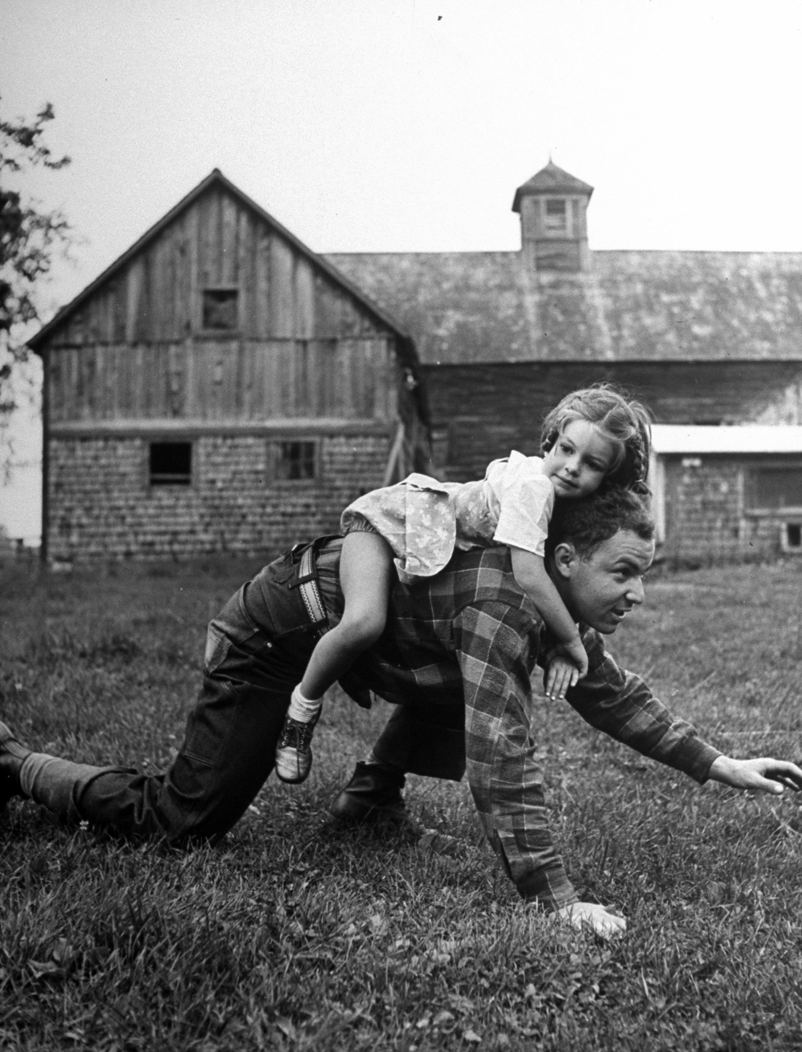 """<b>Caption from LIFE.</b> """"Playing Bear"""" with Murray Blackman is fun for Sandra. Murray went to NYU one year, is studying at the Jewish Institute of Religion in New York to become a rabbi."""