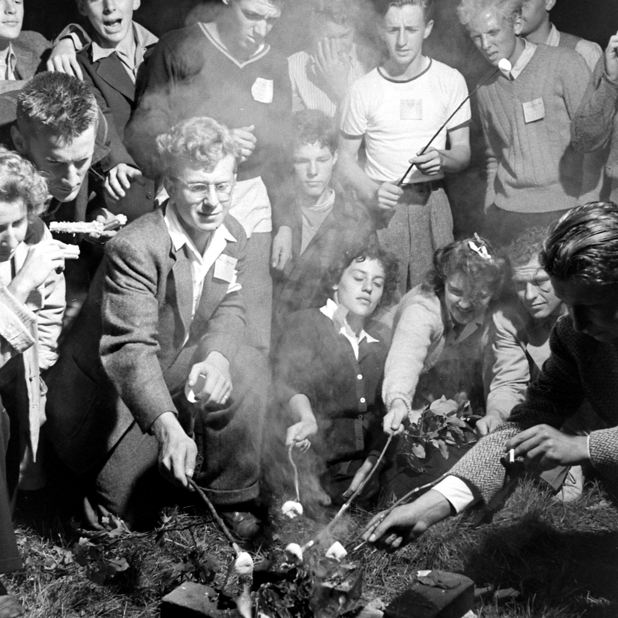 Volunteers with the Land Corps in Vermont roasting marshmallows.