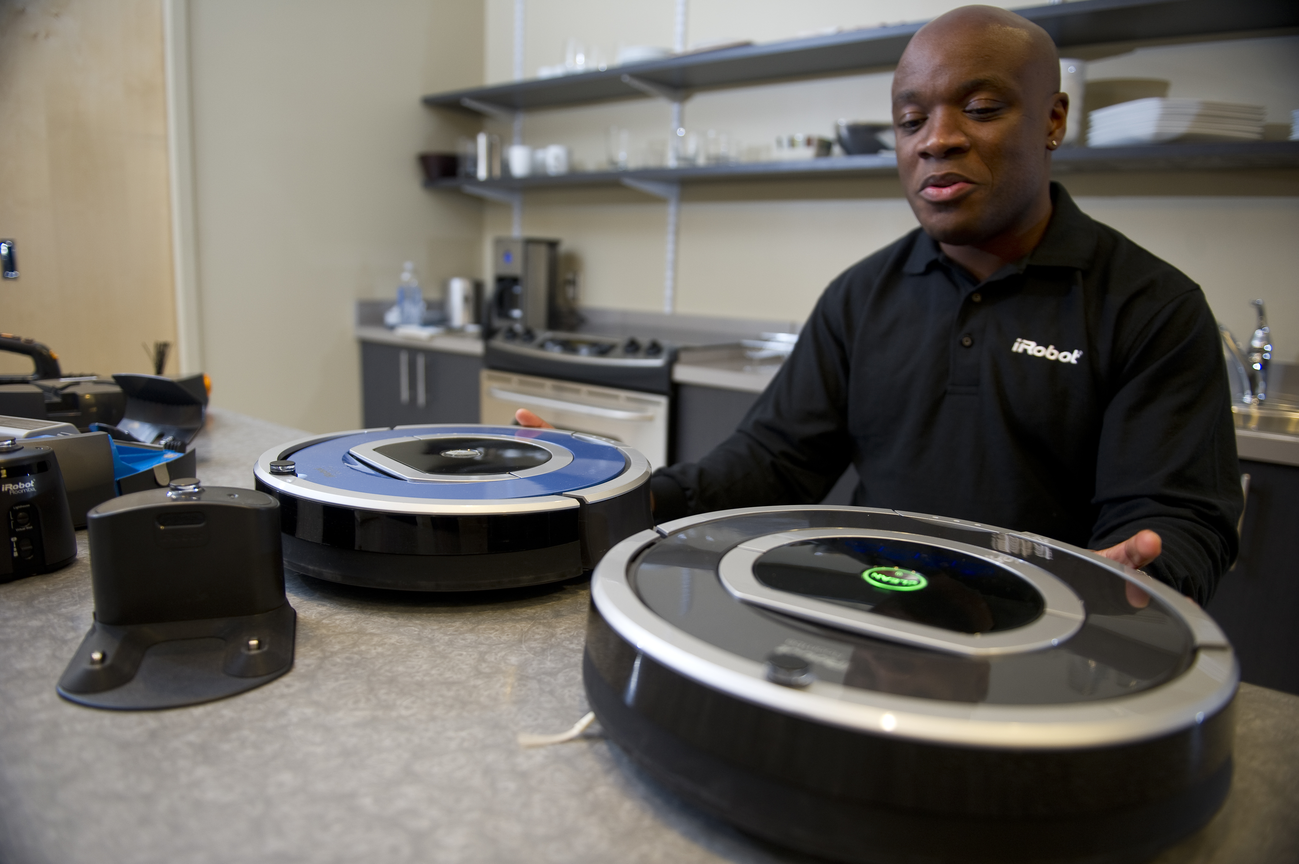 The features of the iRobot Roomba are demonstrated by an iRobot employee in a show room at the iRobot offices, on August 24, 2012 in Bedford, Massachusetts.