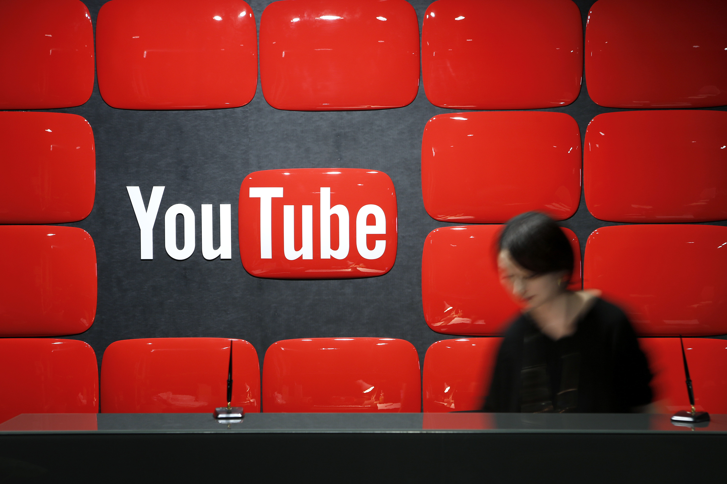 Google Inc.'s YouTube logo is displayed behind the reception desk at the company's YouTube Space studio in Tokyo, Japan, on Saturday, March 30, 2013.