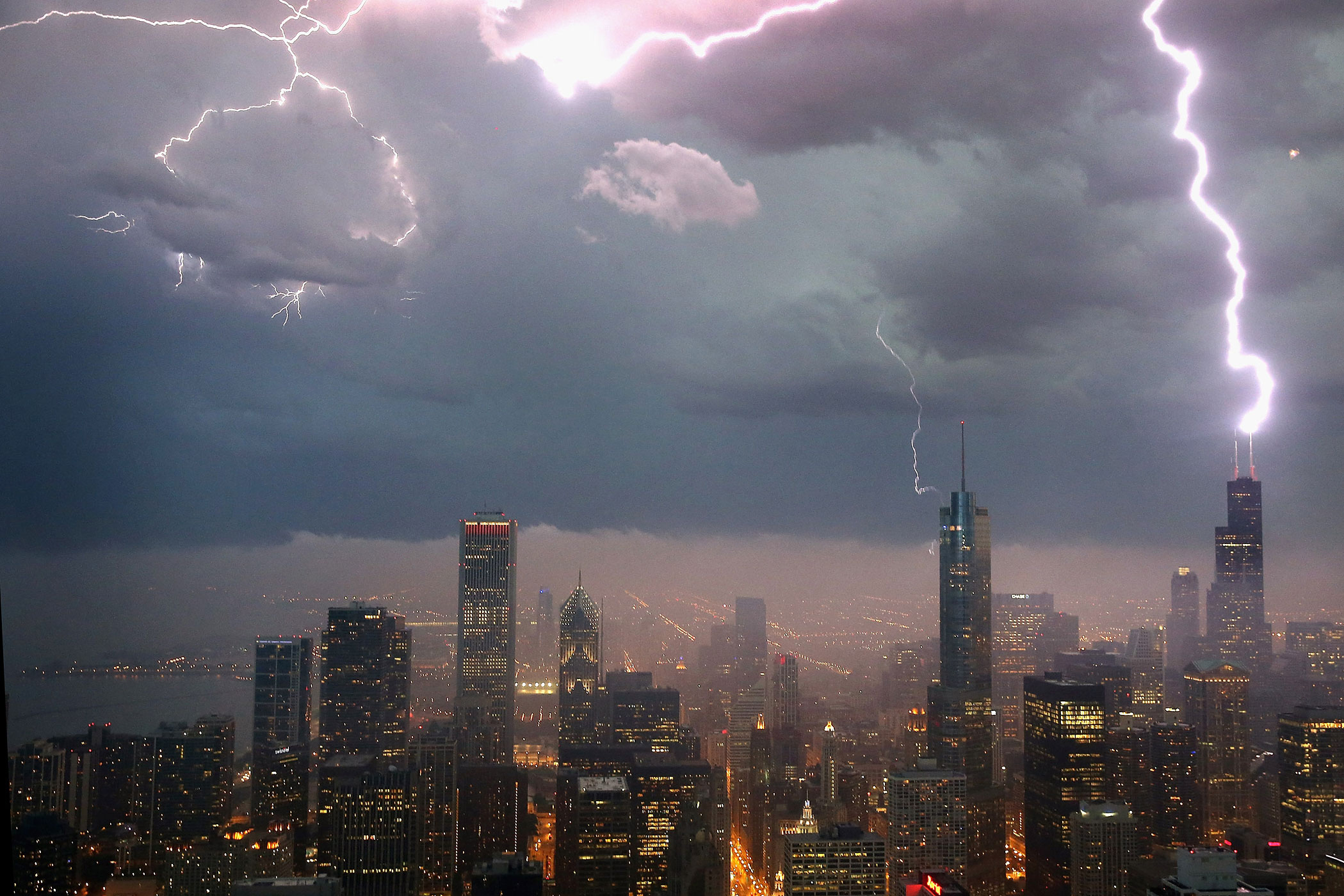 Lightning strikes the Willis Tower in downtown on June 12, 2013 in Chicago.