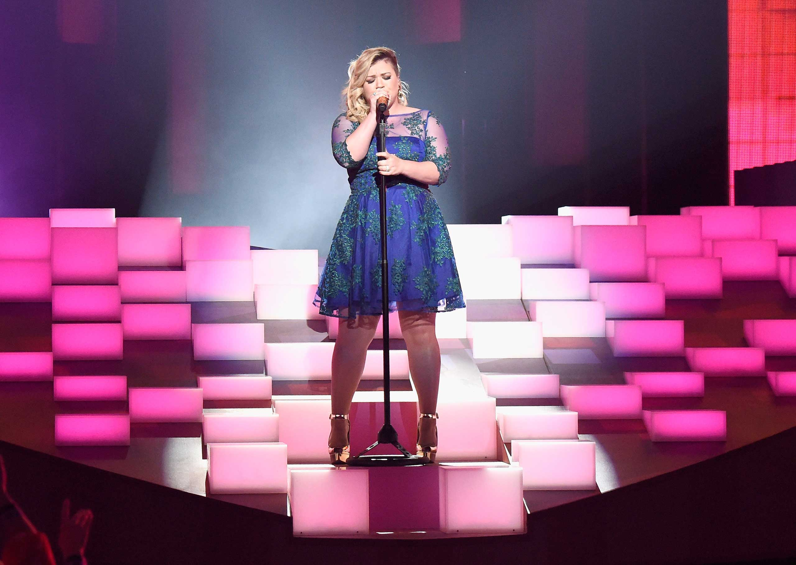 "<b>Kelly Clarkson</b>, season 1 winner, performs ""Heartbeat Song"" onstage during the 2015 iHeartRadio Music Awards at The Shrine Auditorium in Los Angeles on March 29, 2015."