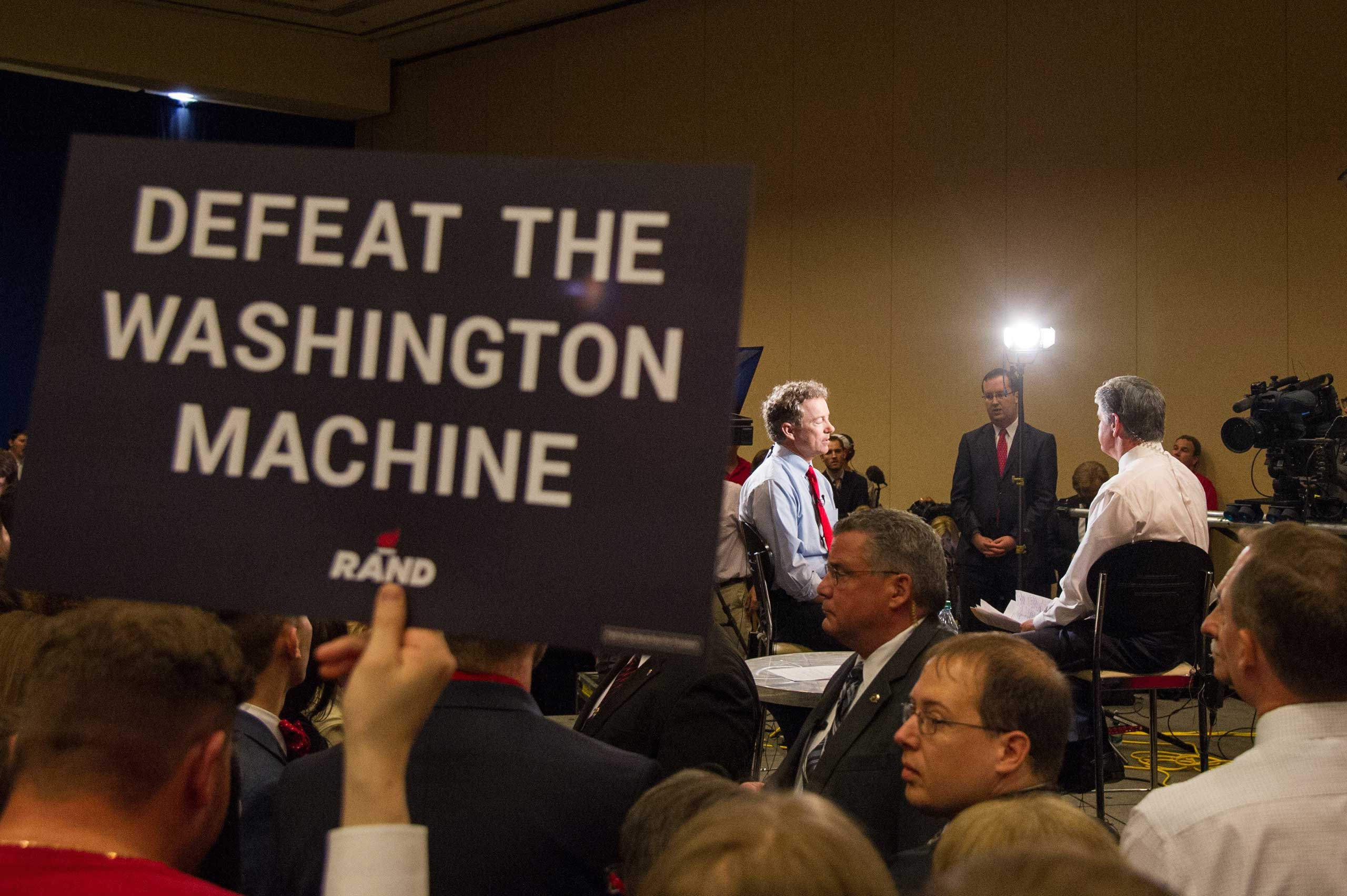 "Kentucky Sen. Rand Paul launched his bid for the Republican nomination at the Galt House Hotel in Louisville on April 7. Supporters held signs with the slogan ""Defeat the Washington Machine / Unleash the American Dream."""