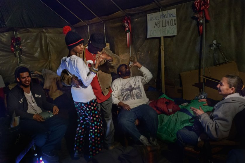 """8 March  2014 - Tent City, Lakewood, New Jersey - Inside Tent City's chapel, """"Uncle Mike""""  dances salsa with Eve."""