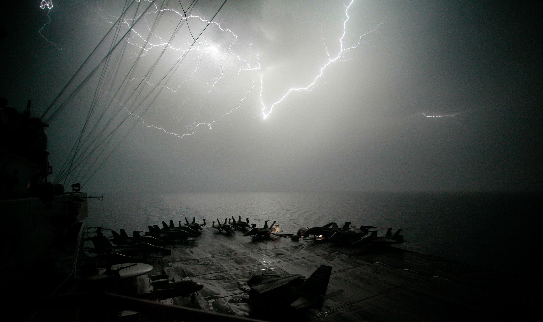 Lightning strikes over the flight deck of the Nimitz-class aircraft carrier USS John C. Stennis (CVN 74) as the ship transits through the Persian Gulf, March 28, 2007.