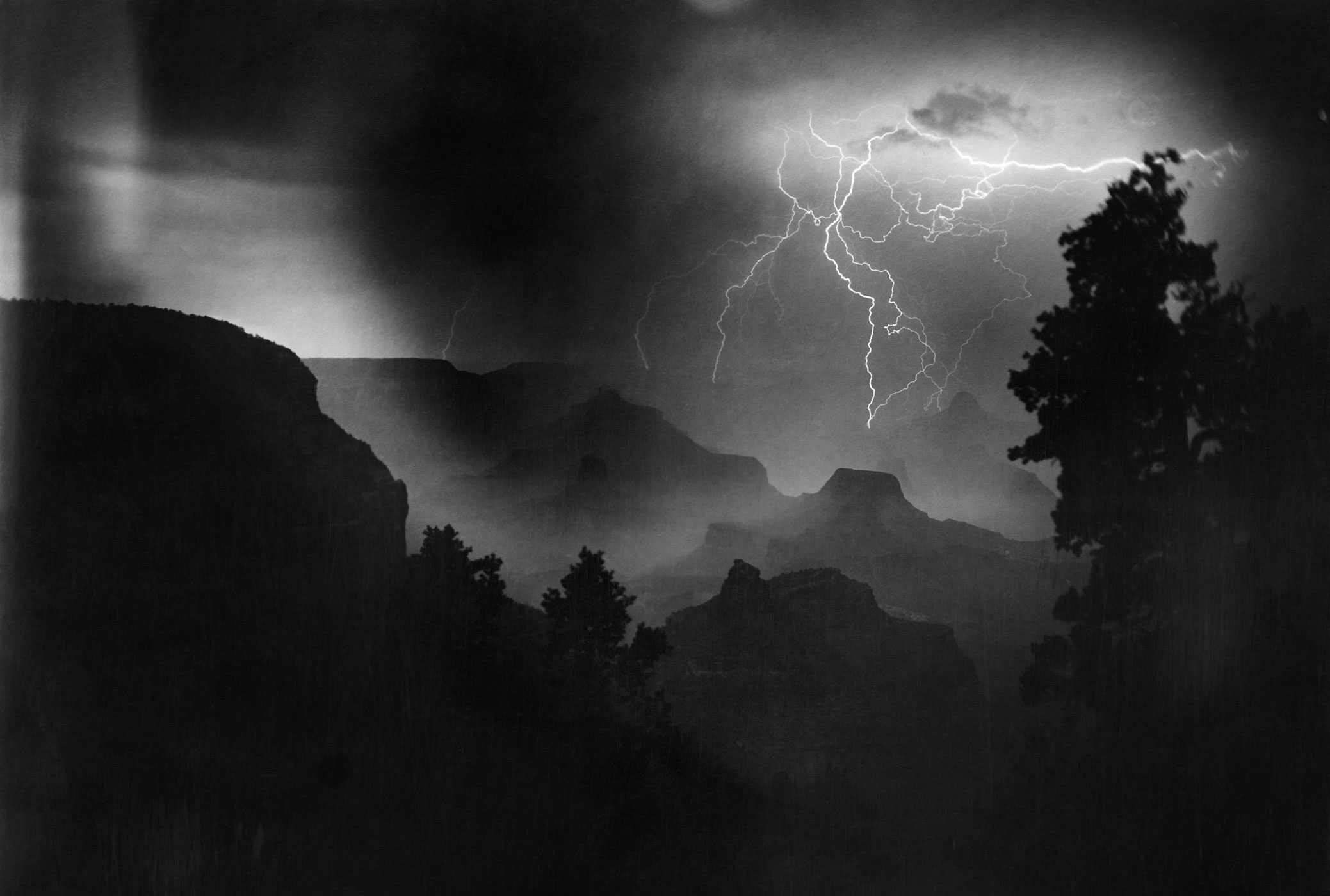 Lightning strikes during an electrical storm at night in the Grand Canyon.