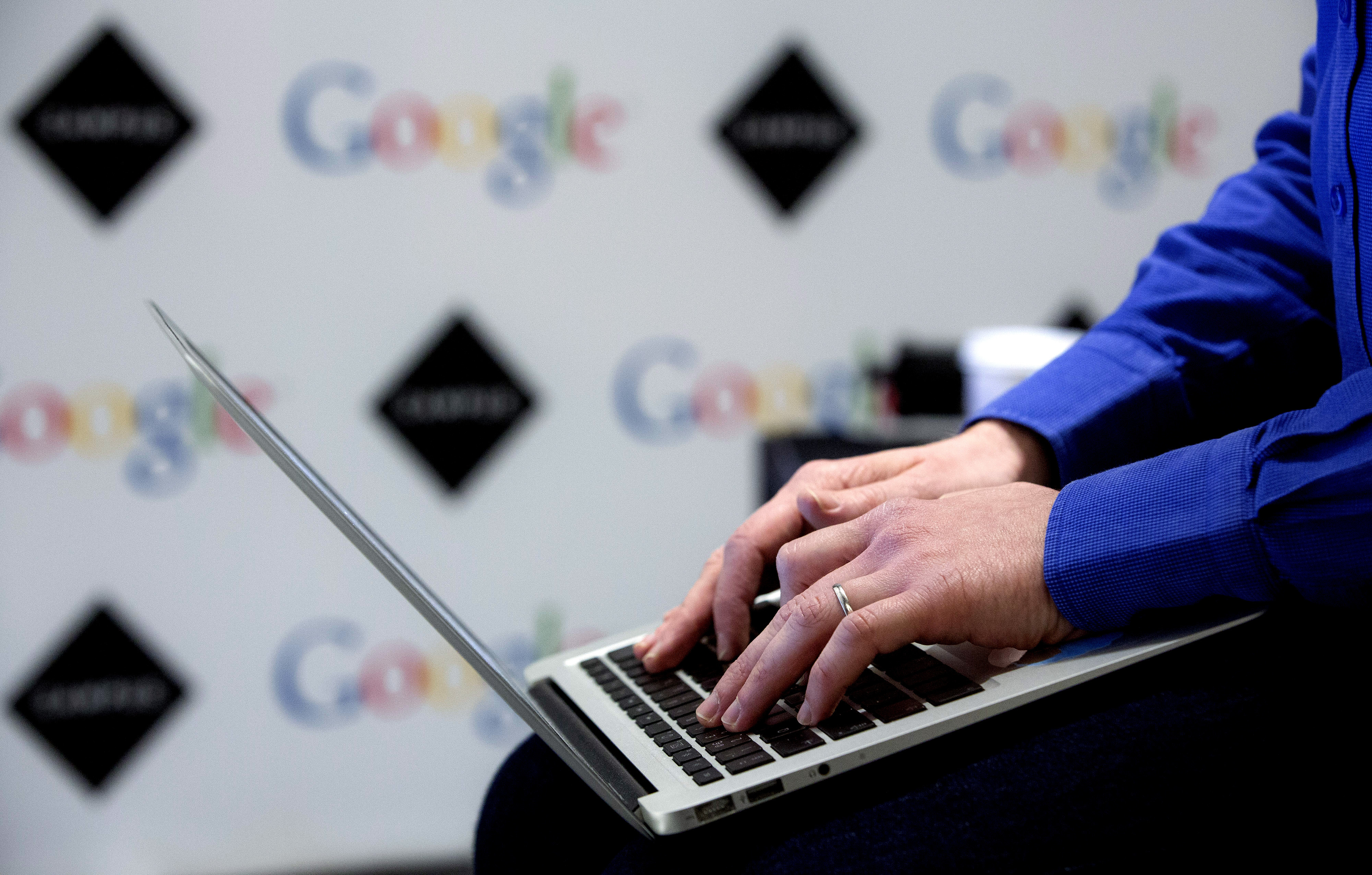 A visitor uses a laptop computer at Google Inc.'s London Campus, in London, U.K., on Monday, Dec. 2, 2013.