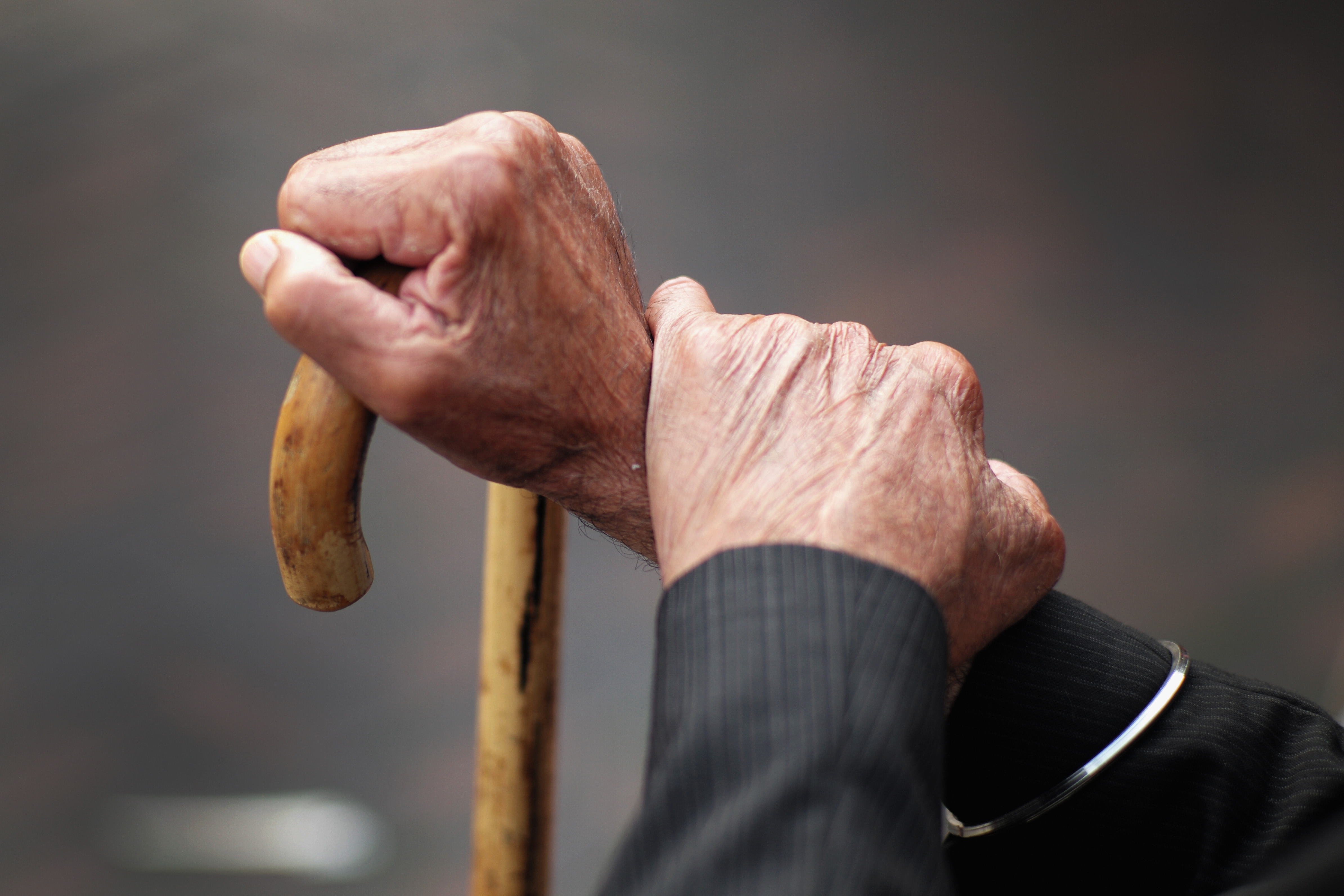 A pensioner holds his walking stick on September 8, 2014 in Walsall, England.