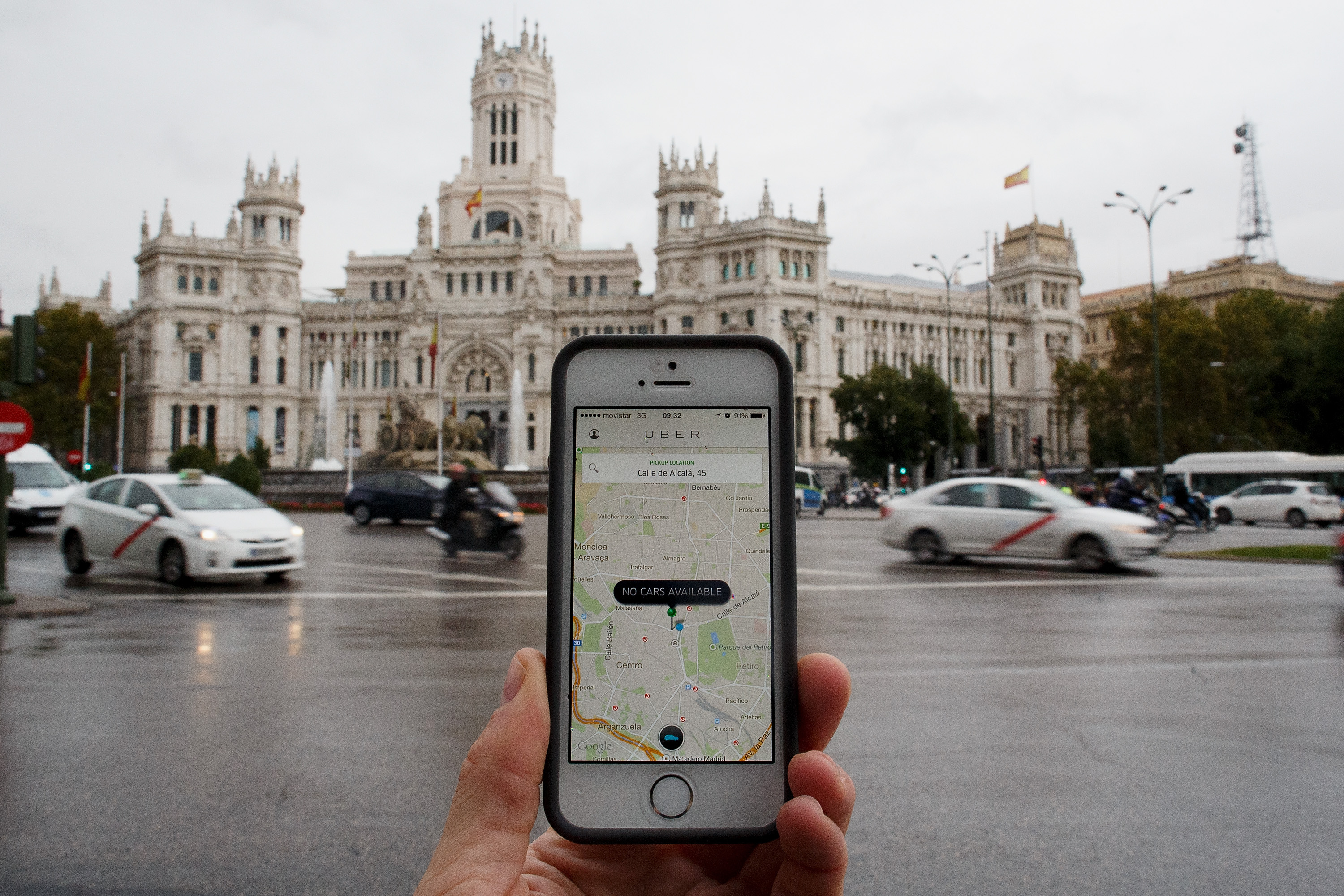 In this photo illustration the smart phone taxi app 'Uber' shows how to select a pick up location at Cibeles Square on October 14, 2014 in Madrid, Spain.