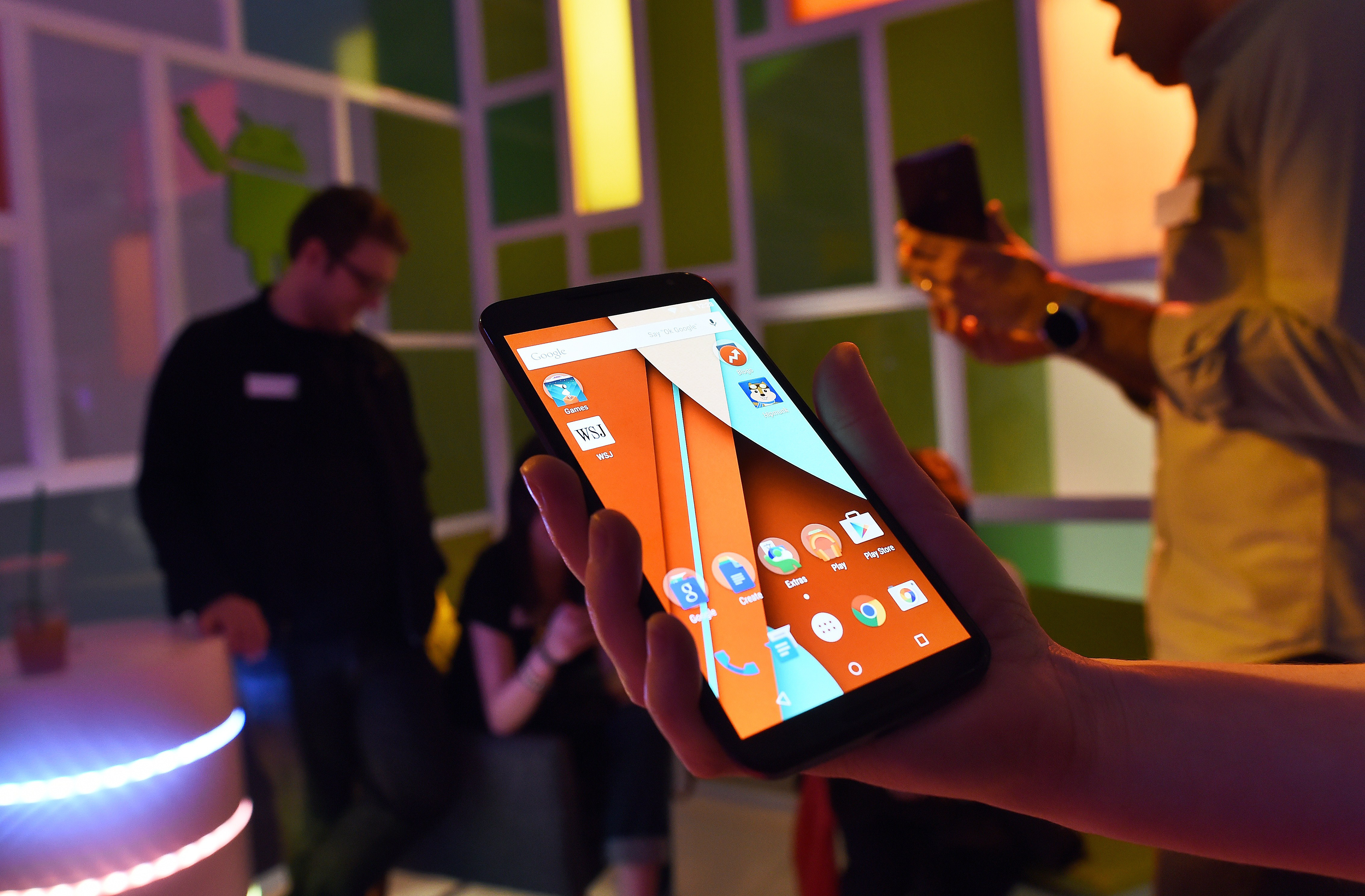 Journalists take a look at Google's newest smartphone nexus 6 during a media preview in New York on October 29, 2014.