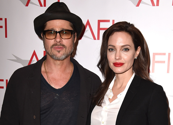 Brad Pitt and Angelina Jolie arrive at the 15th annual AFI Awards at the Four Seasons Hotel in Los Angeles on Jan. 9, 2015