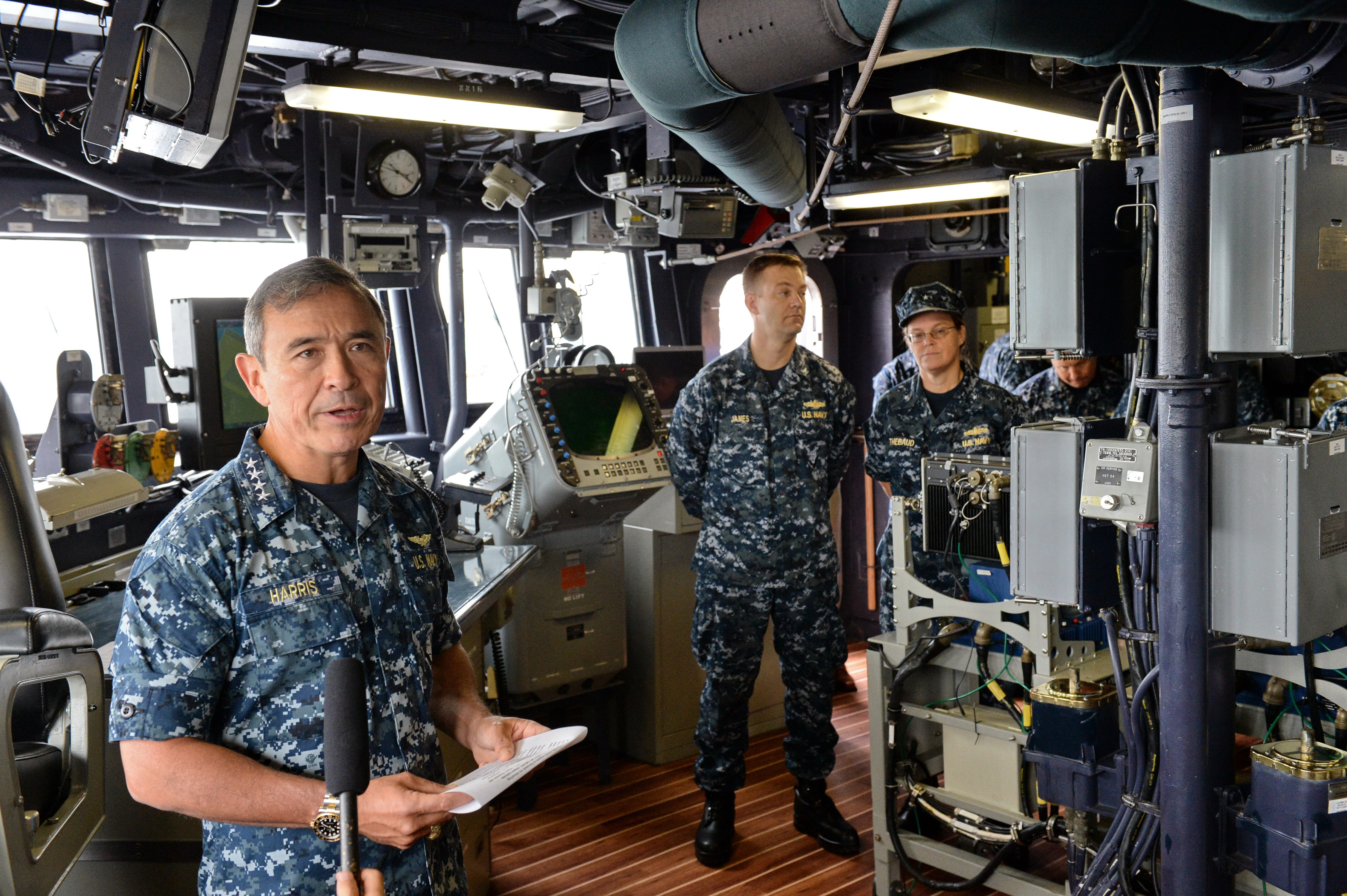 U.S. Navy's Pacific Fleet commander Admiral  Harry Harris, left, speaks to journalists during his visit to U.S.S. Spruance (DDG 111), Arleigh Burke–class guided-missile destroyer, docking in Sembawang wharves in Singapore on Jan. 22, 2014