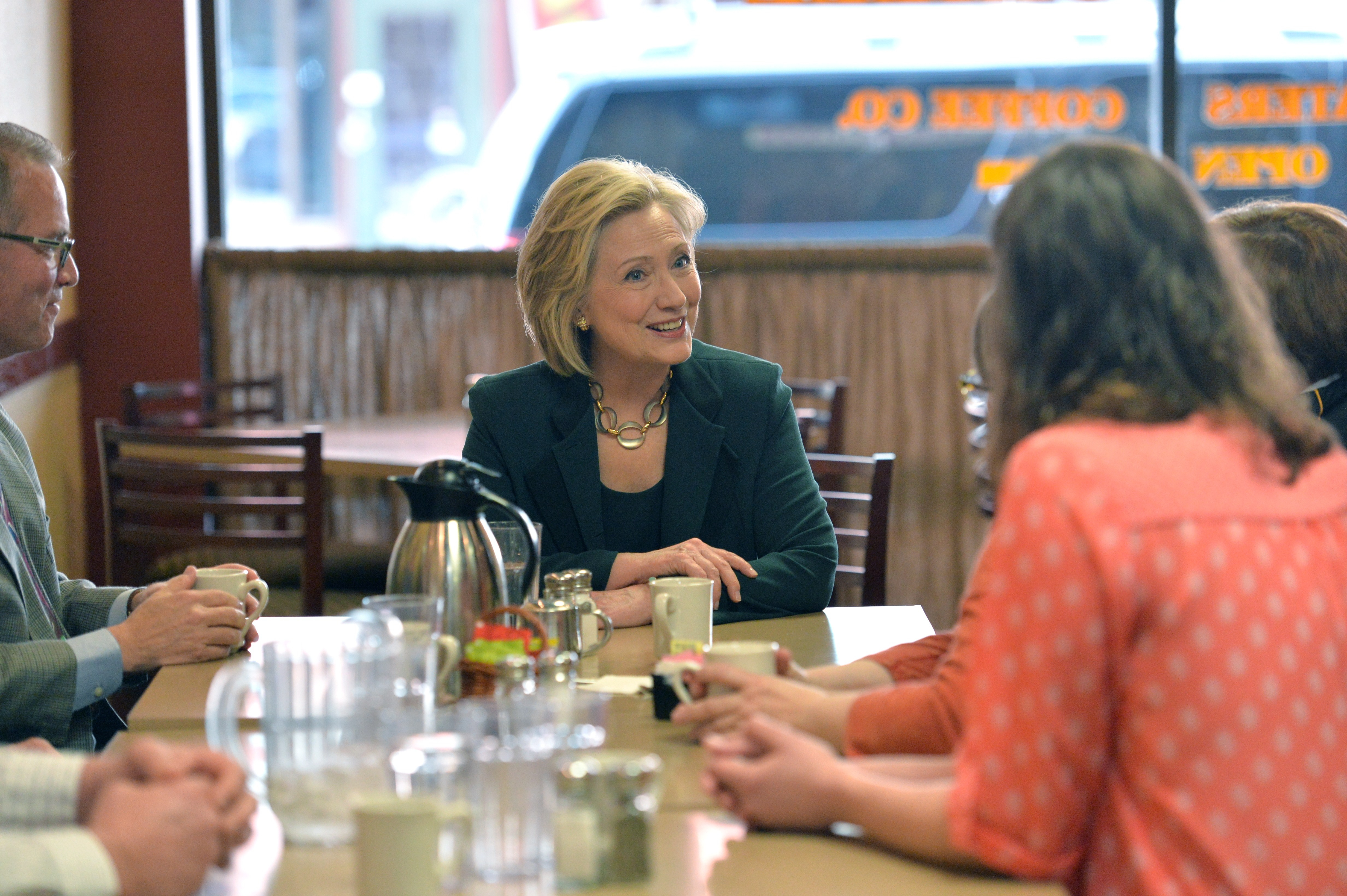 """Marshalltown, IA - April 15: Clinton had coffee and spoke with customers during her first Iowa visit. Many of her advisors think she performs best in small groups with voters, so her campaign began with a carefully planned """"listening tour."""""""