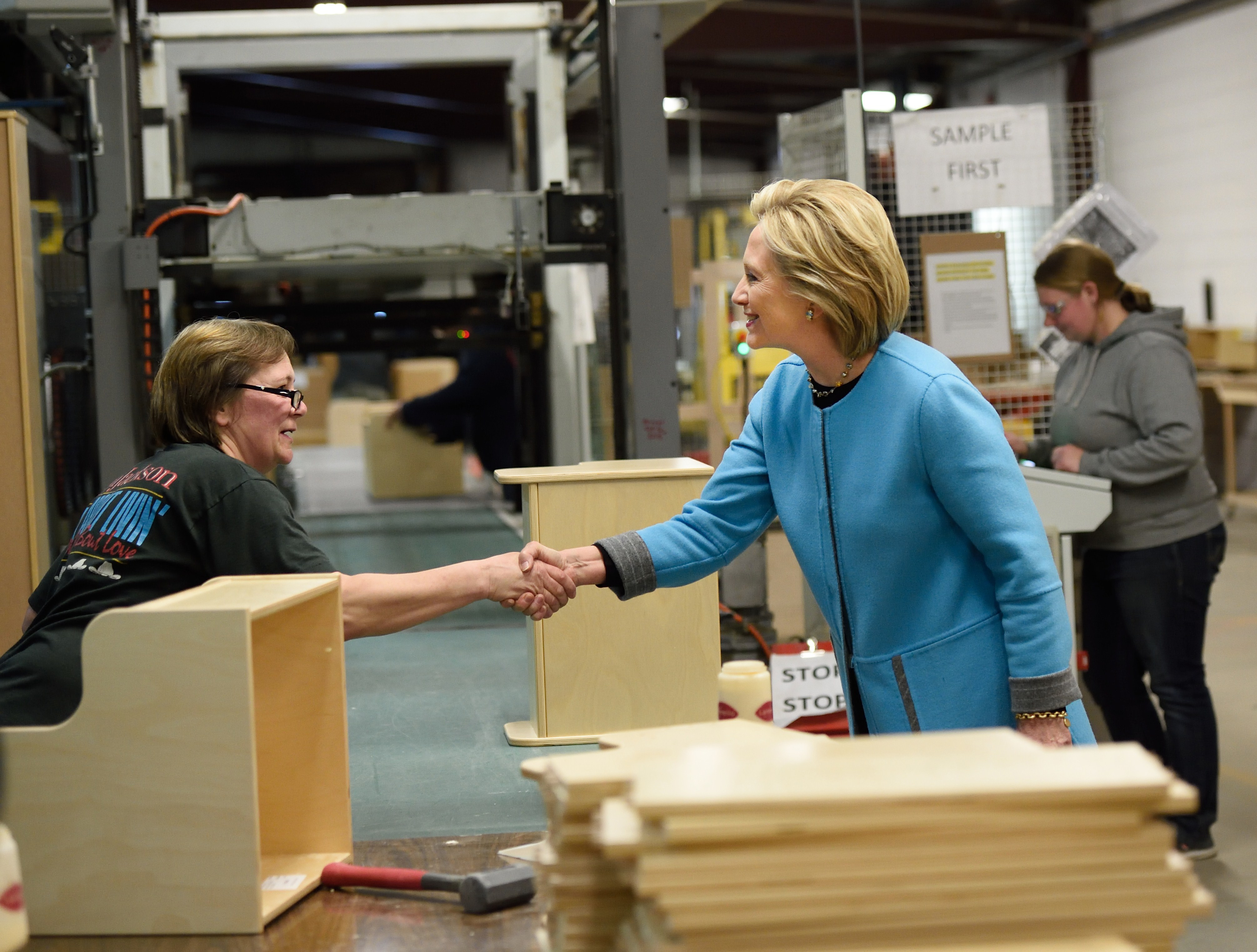 Keene, N.H. - April 20: Clinton visited a family-owned children's furniture factory to talk small business and manufacturing. Planks of wood, stacked boxes and heavy machinery formed an ideal backdrop.