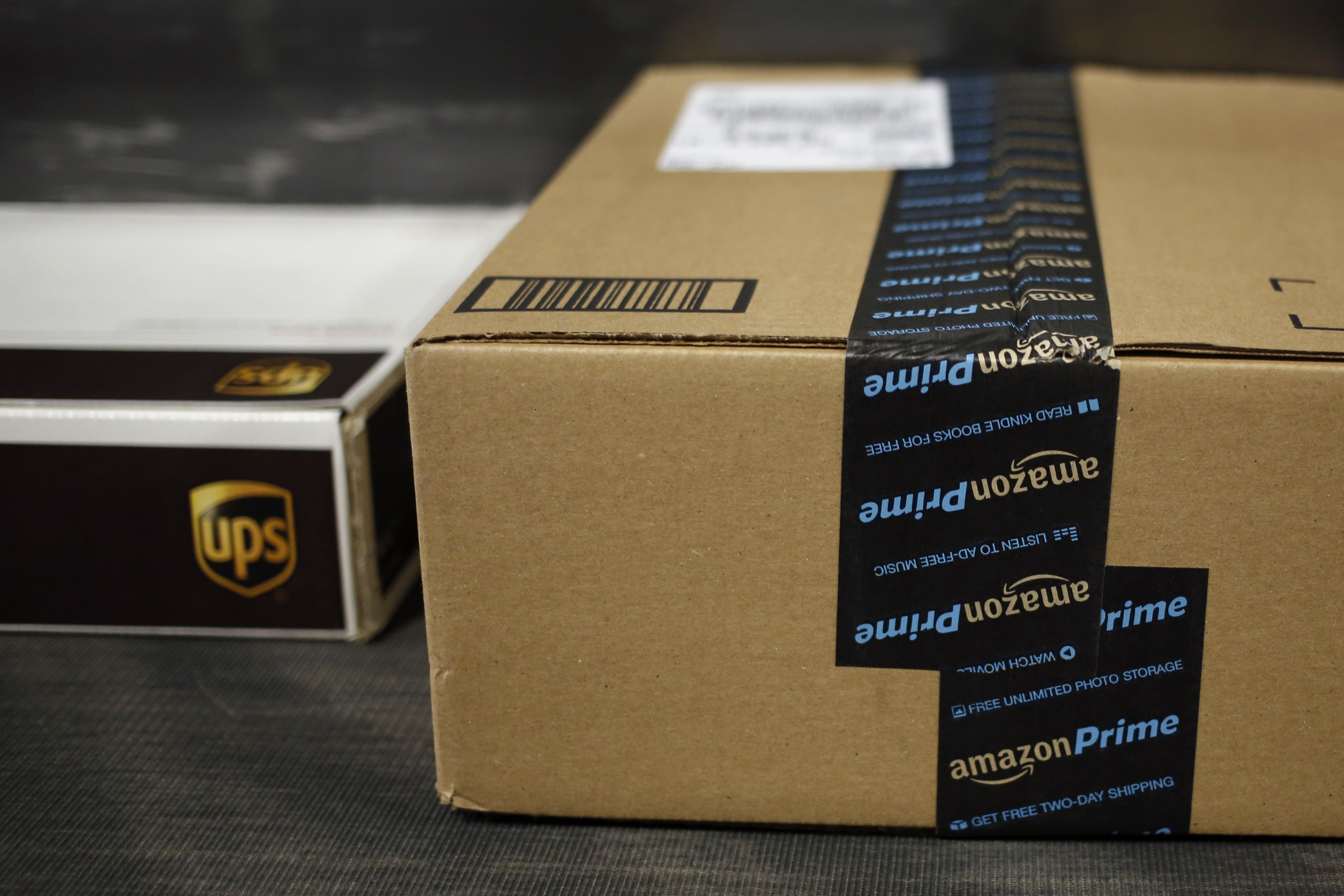 A package shipped from Amazon.com moves down a conveyor belt during the afternoon sort at the United Parcel Service Inc. (UPS) Worldport facility in Louisville, Kentucky, U.S., on Tuesday, April 21, 2015.