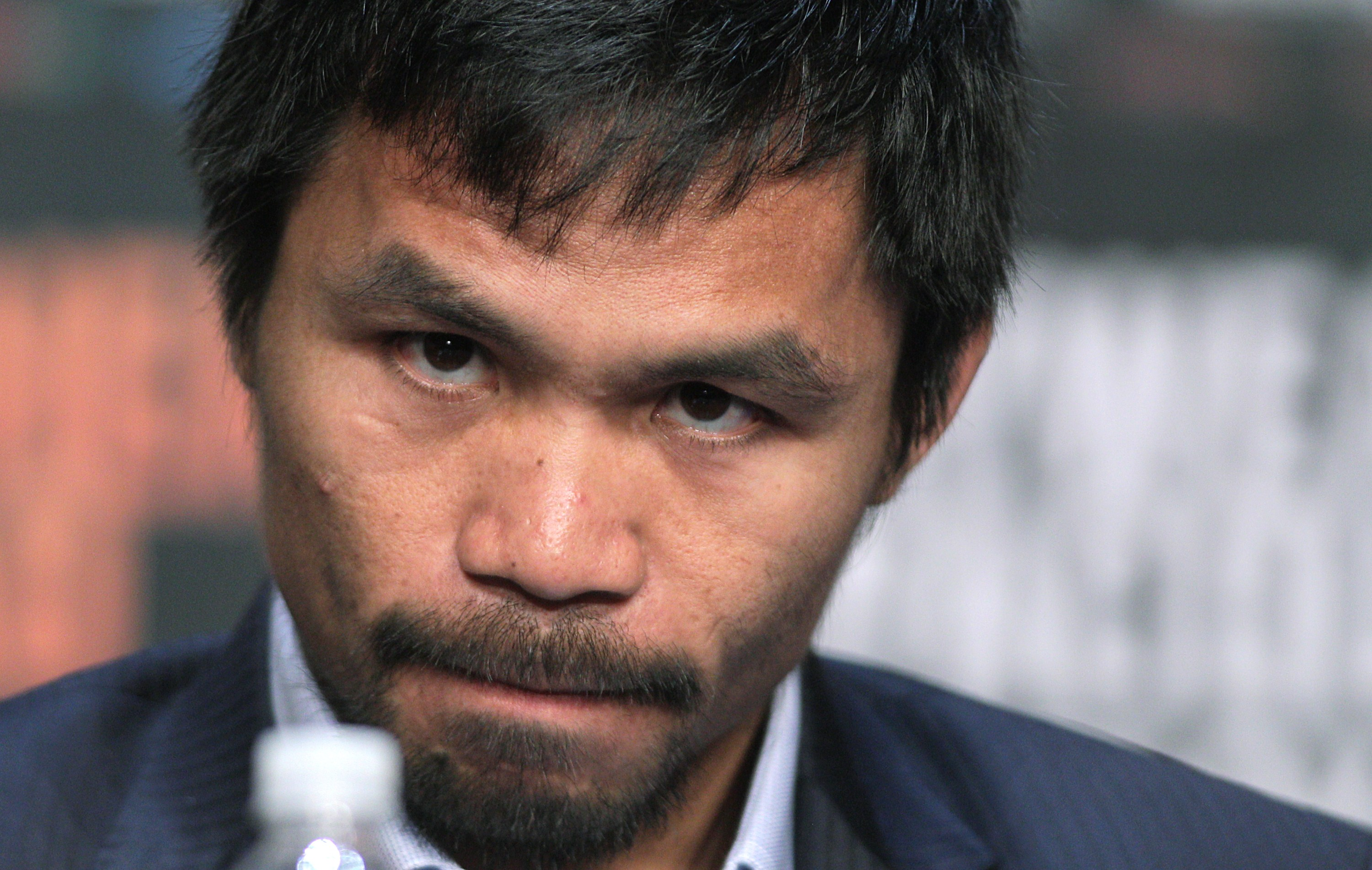 WBO welterweight champion Manny Pacquiao  listens during a news conference at the KA Theatre at MGM Grand Hotel & Casino on April 29, 2015 in Las Vegas, Nevada.