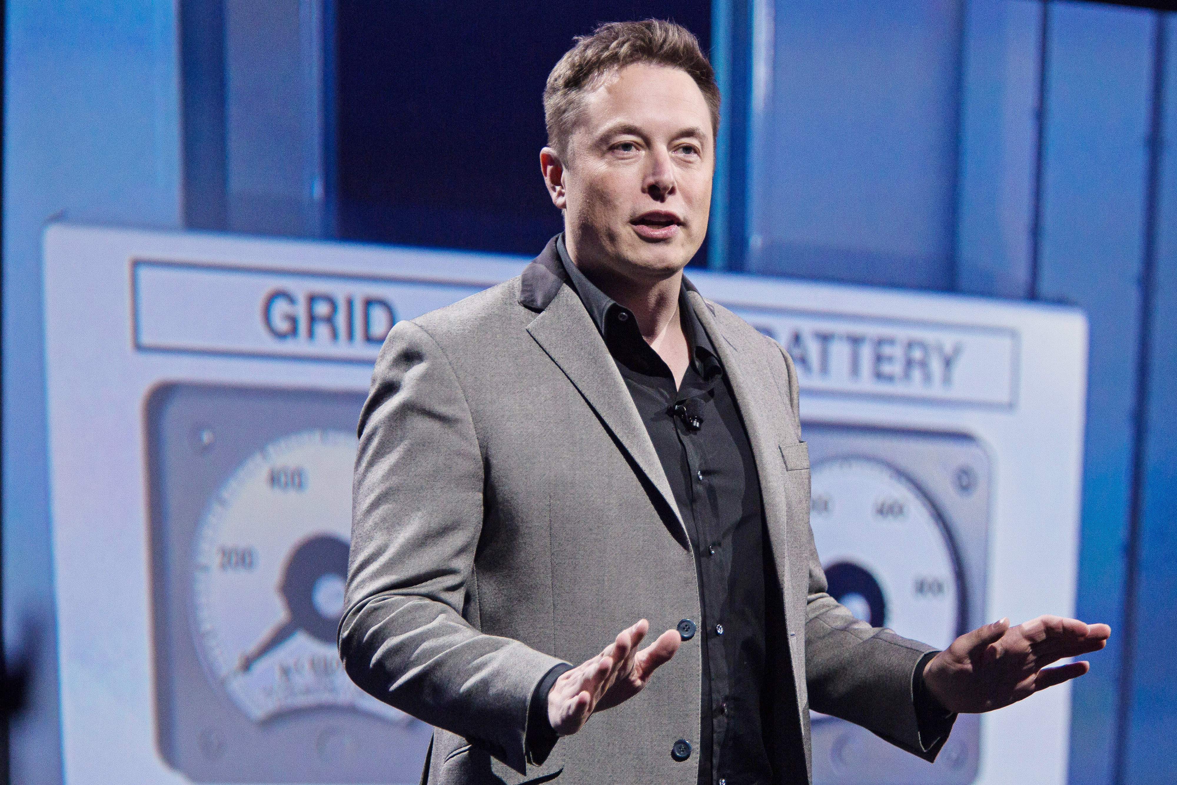 Elon Musk, co-founder and chief executive officer of Tesla Motors Inc., speaks during the unveiling of the company's  Powerwall' at an event in Hawthorne, California, U.S., on Thursday, April 30, 2015. Musk unveiled a suite of batteries to store electricity for homes, businesses and utilities, saying a greener power grid furthers the company's mission to provide pollution-free energy. Photographer: Tim Rue/Bloomberg via Getty Images
