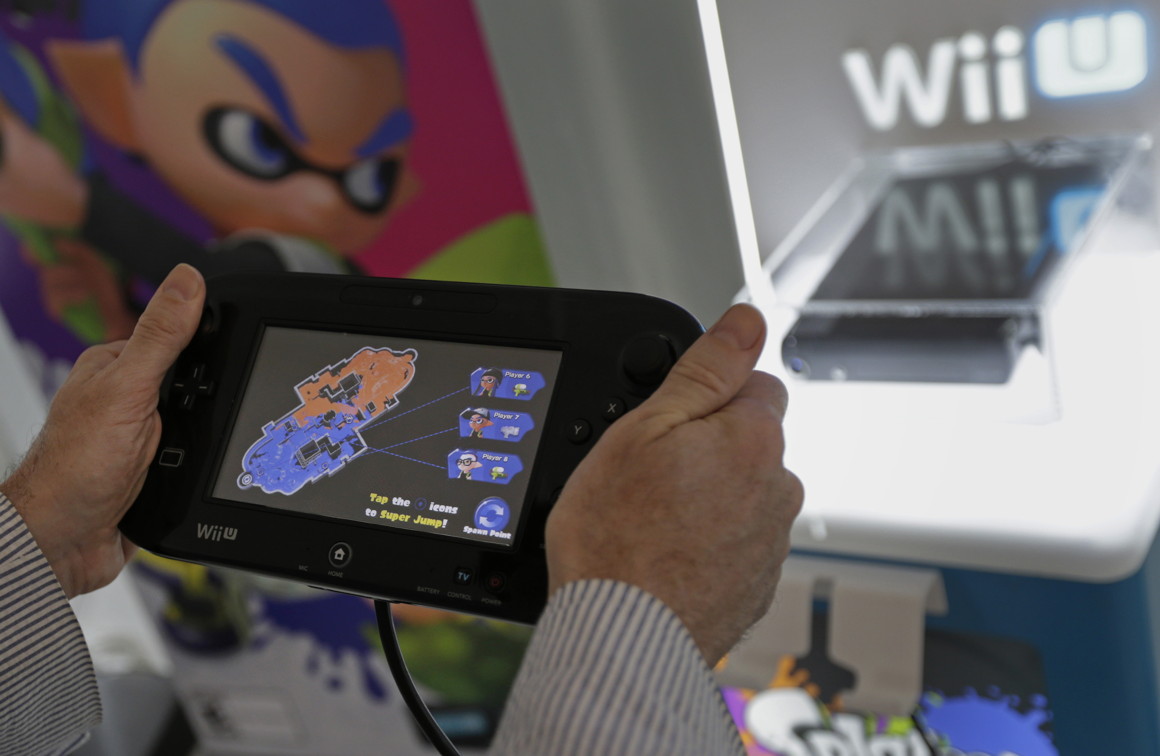 A video gamer tries out the Nintendo's new touch screen game pad controller with gyroscopic controls and their newest game 'Splatoon'  at a pre-launch event in New York, U.S., on Wednesday May 6th 2015.