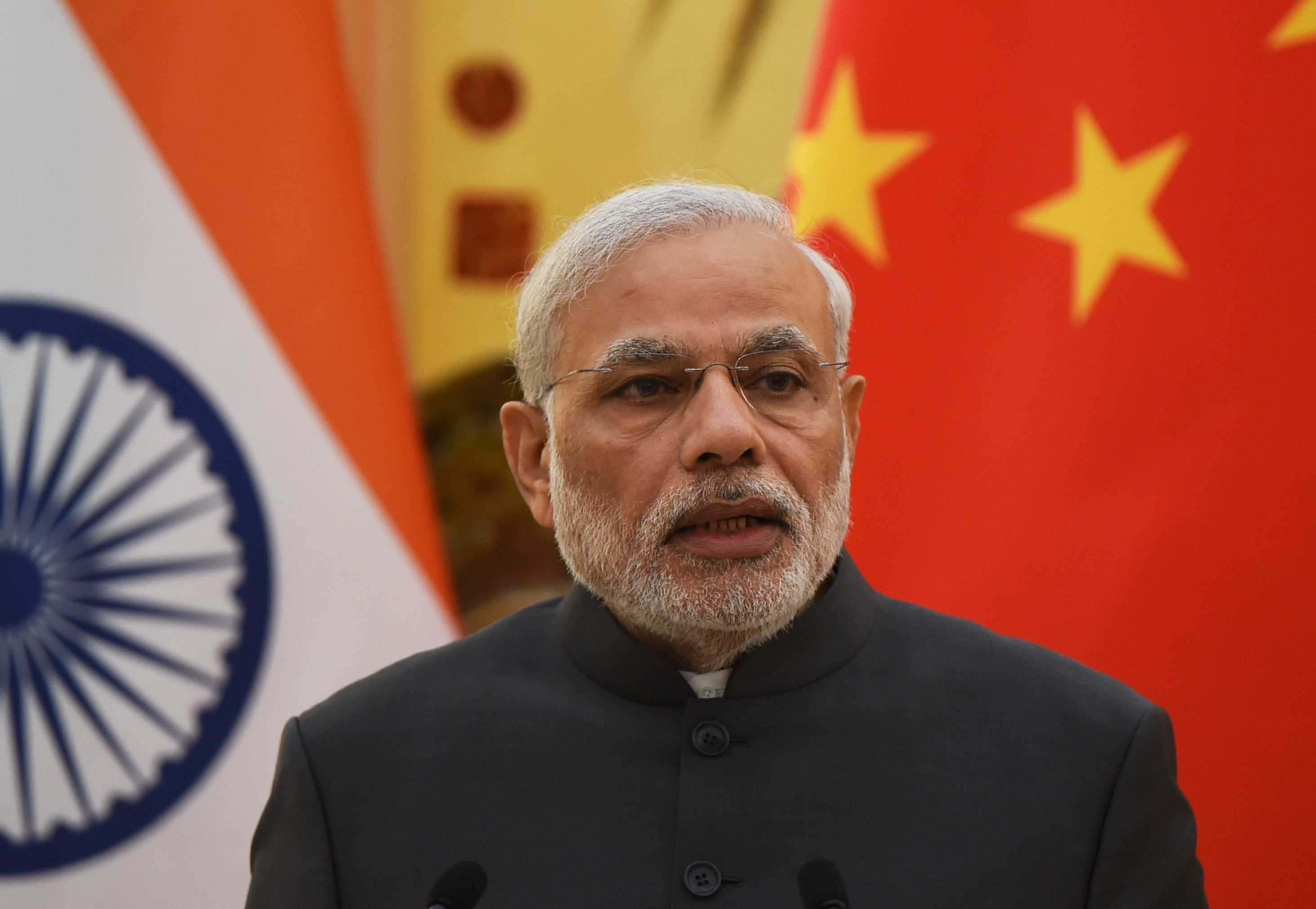India's Prime Minister Narendra Modi speaks at a joint press conference with Chinese Premier Li Keqiang (not seen) in the Great Hall of the People in Beijing on May 15, 2015