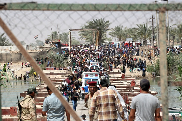 Ramadi residents flee their city after ISIS fighters took control of it on Saturday.