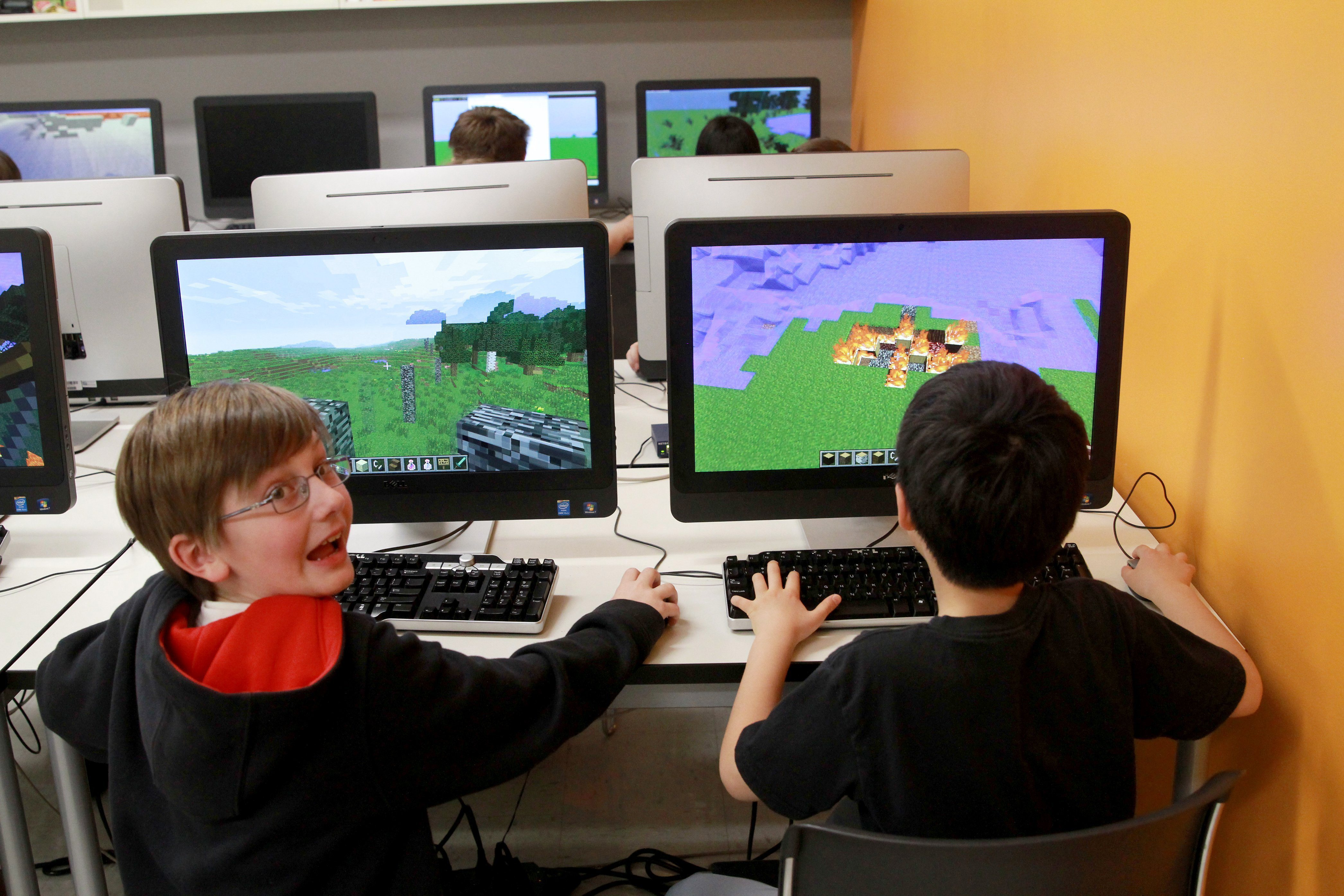 Bobby Craig, left, and Doogy Lee create worlds in Minecraft that parallel what they have bene reading in  The Hobbit  as part of their fifth grade class studies at Quest Academy in Palatine, Ill.