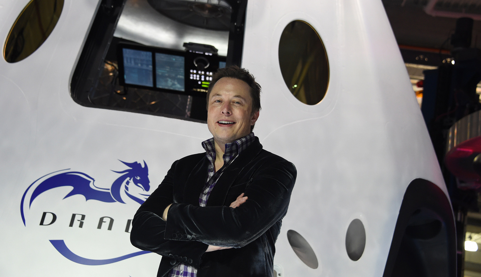 SpaceX CEO Elon Musk introduces SpaceX's Dragon V2 spacecraft, the company's next generation version of the Dragon ship designed  to carry astronauts into space, at a press conference in Hawthorne, Calif. on May 29, 2014.