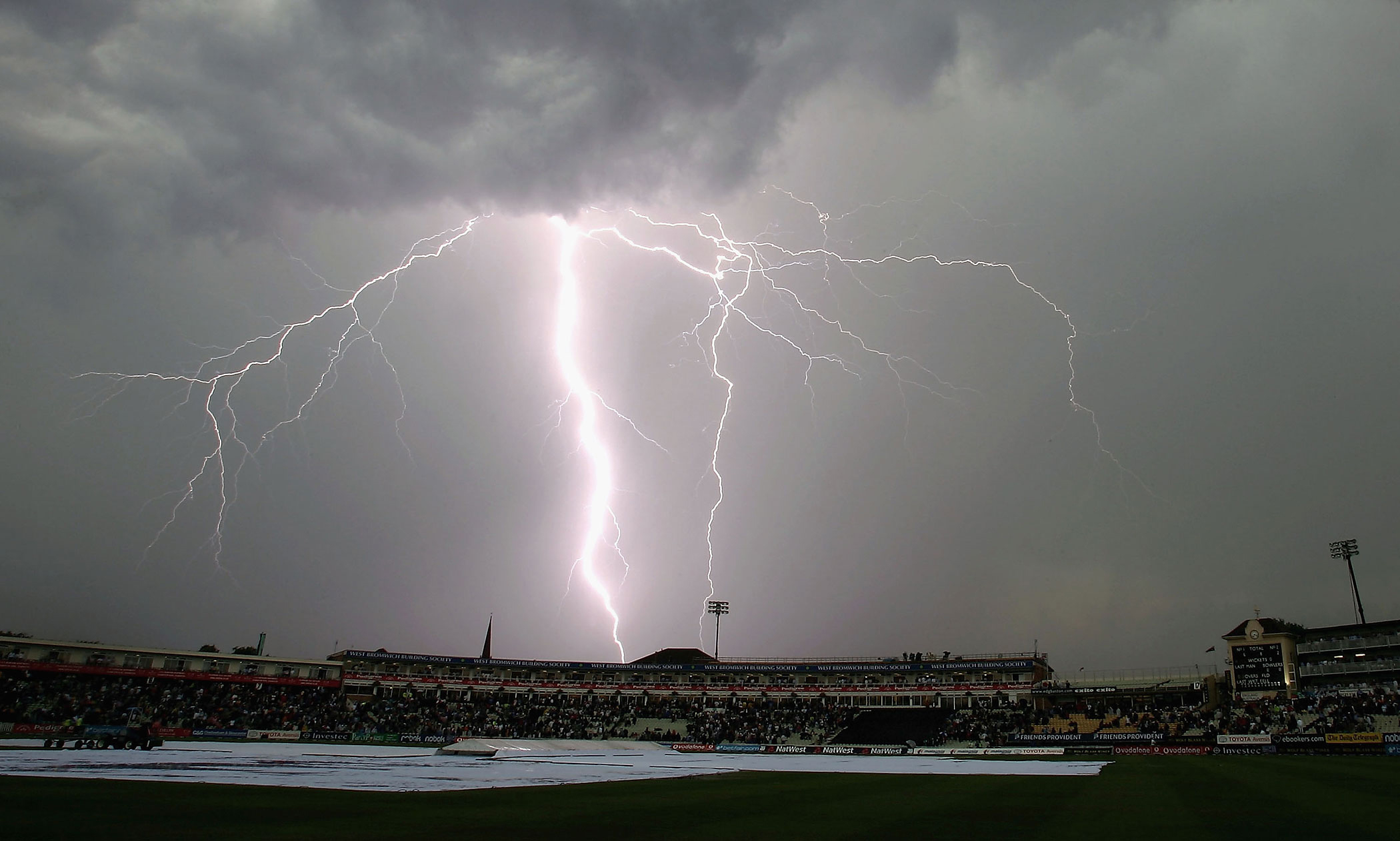 Lightning strikes as the players leave the field due to the electrical storm during the NatWest Series One Day International between England and Australia played at Edgbaston in Birmingham, United Kingdom, June 28, 2005.