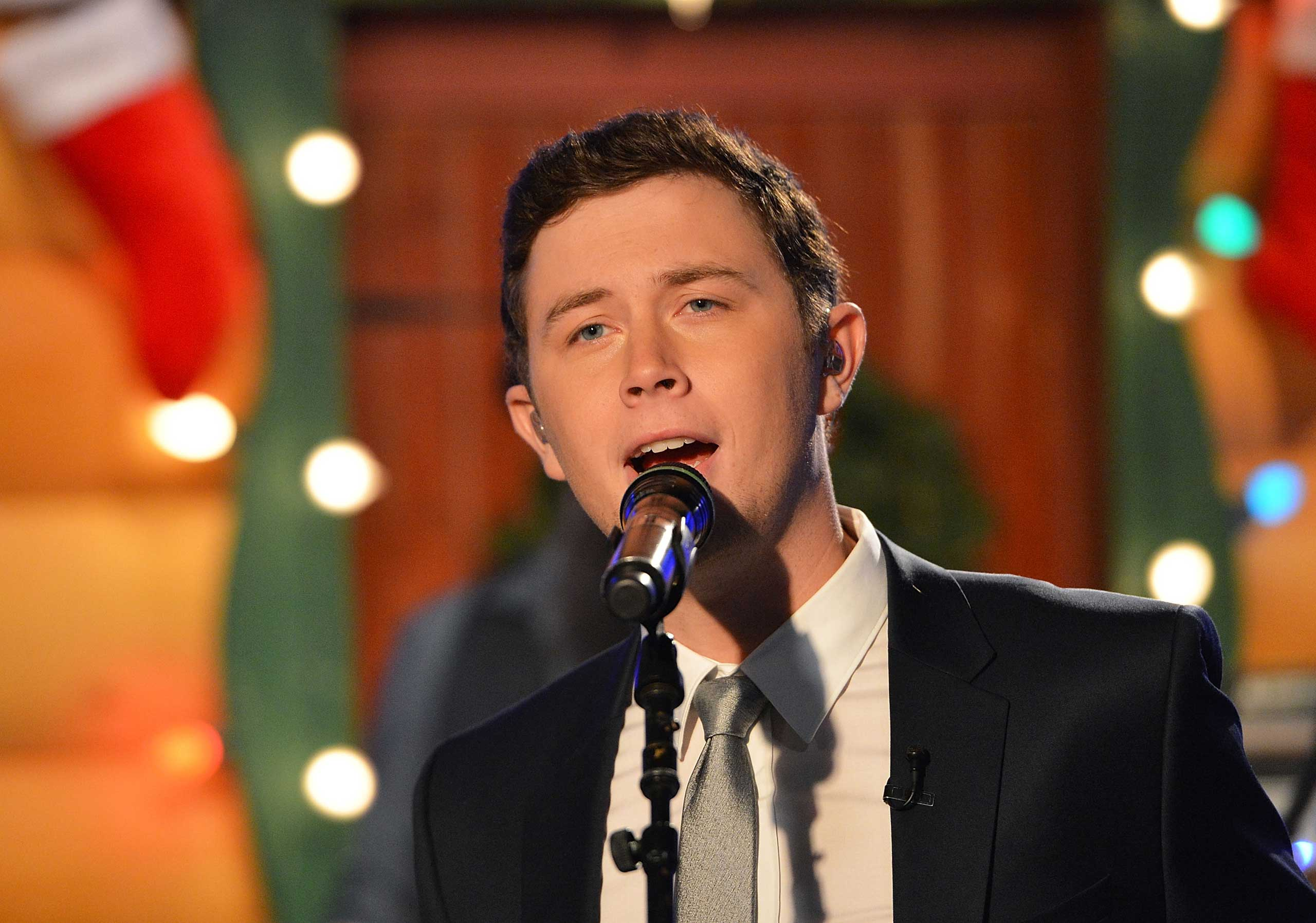"<b>Scotty McCreery</b> performs during ""FOX &amp; Friends"" holiday special at FOX Studios in New York City on Dec. 4, 2014. McCreery won season 10 of <i>American Idol</i>."