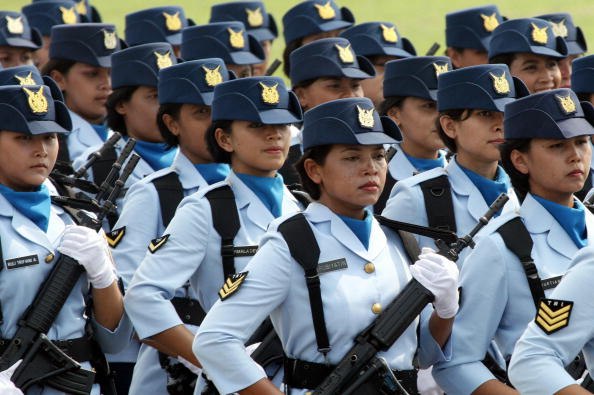 Indonesian air-force female soldiers parade during a ceremony in Jakarta on April 9, 2007