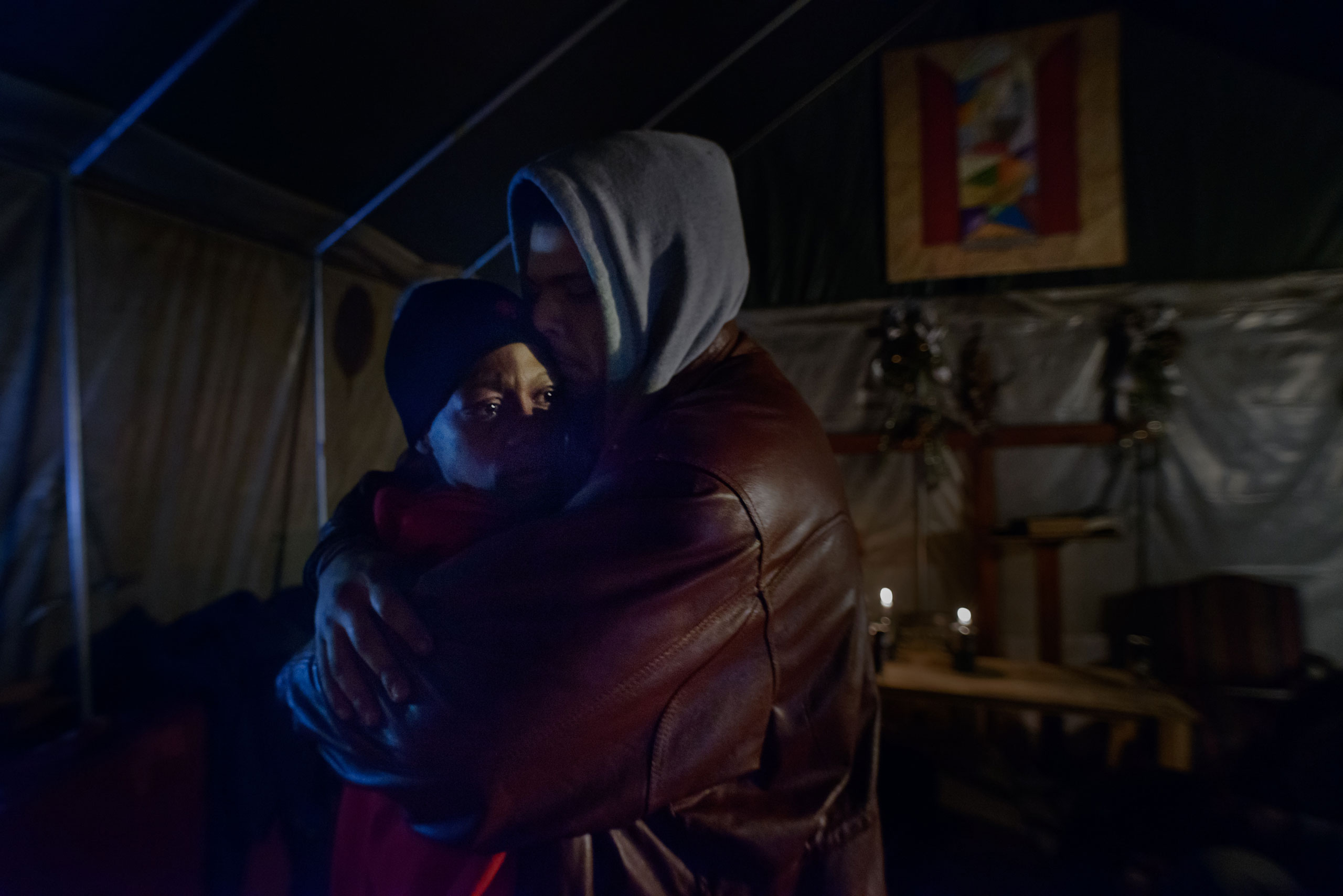Inside Tent City's chapel, Chris consoles his wife Eve after an argument, March 14, 2014.