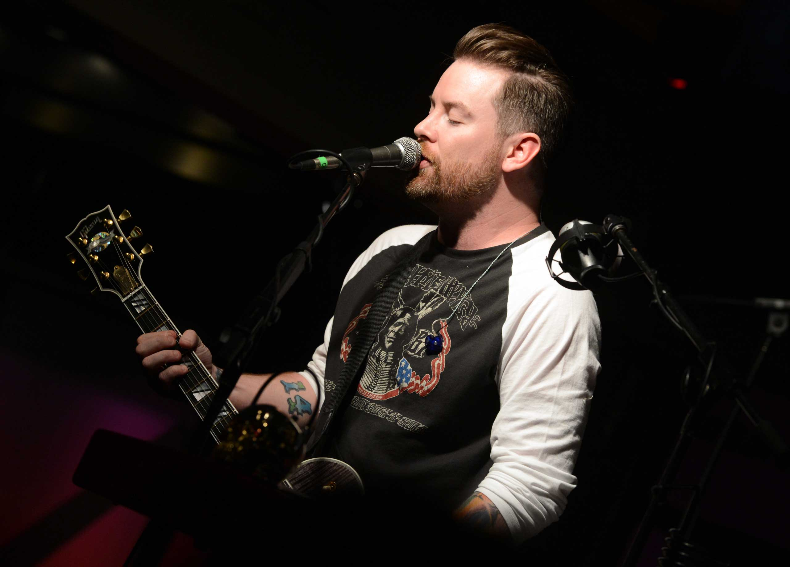 <b>David Cook</b>, season 7 winner, performs at the Soles4Souls charity concert, sponsored by Barefoot Wine &amp; Bubbly at the Bridge Building in Nashville on April 1, 2014.