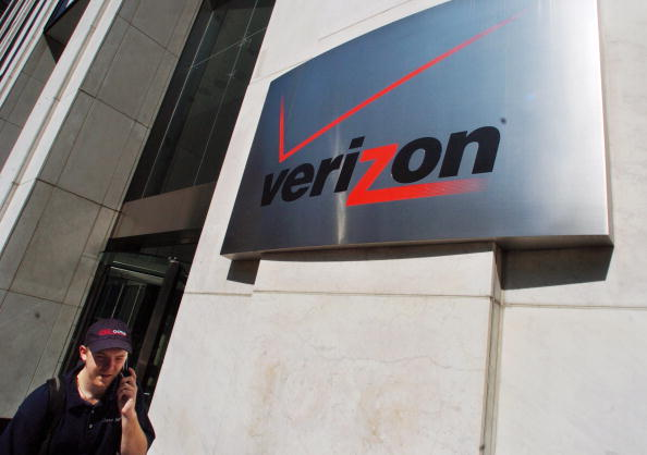 A pedestrian walks past the Verizon Communications Inc. headquarters in New York City on July 26, 2005.