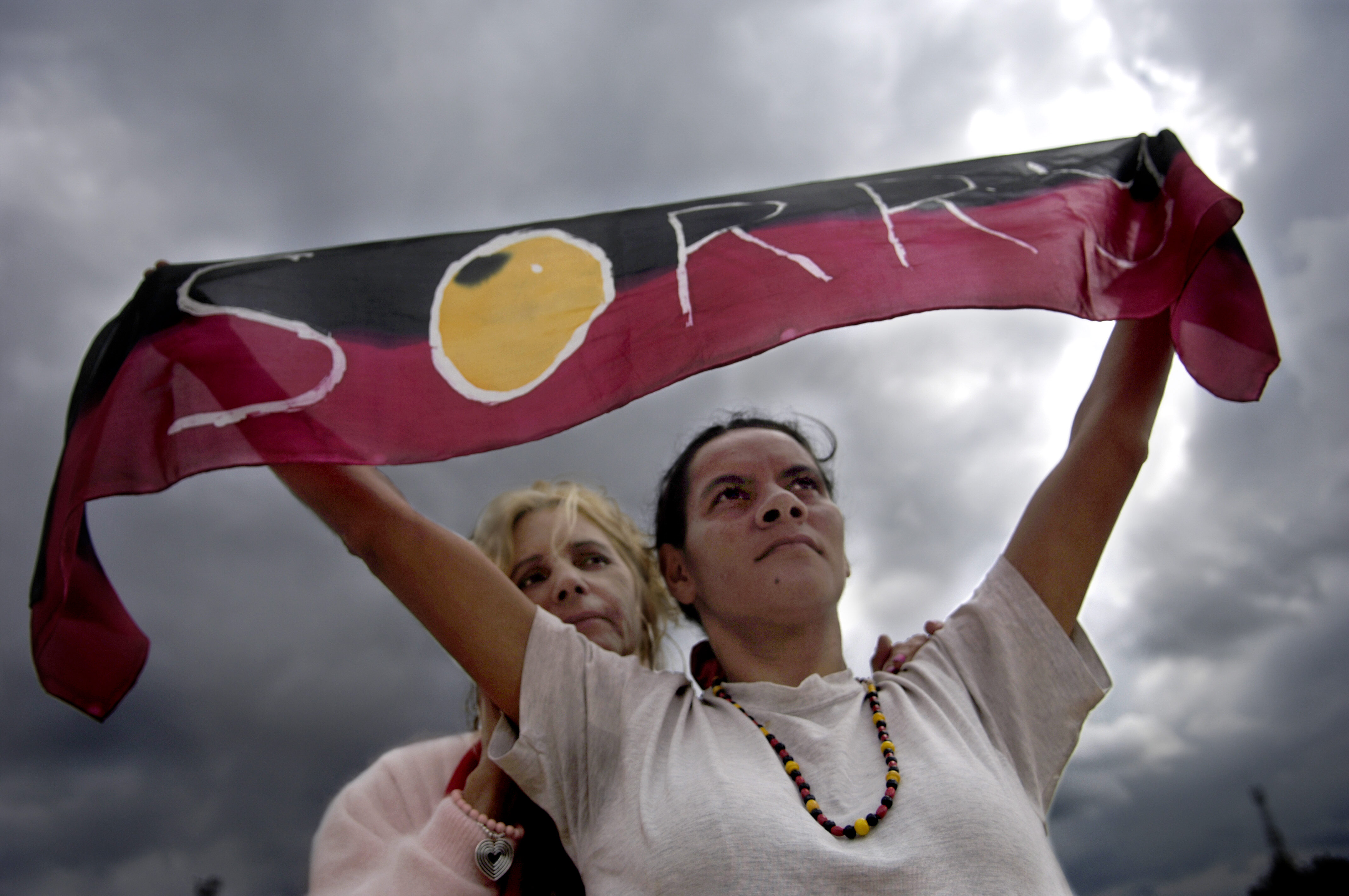 Rhonda Randall and Sharon Mumbler stand proud with their  Sorry  scarf as  Kevin Rudd's Broadcast apology to Aboriginal Peoples of Australia at Penrith Council on February 13, 2008 in Penrith, Australia.