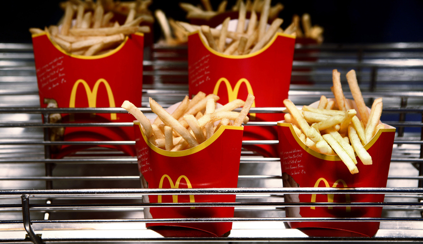 Cartons of McDonald's french fries sit at a restaurant in London, U.K., on Monday, Feb. 1, 2010.