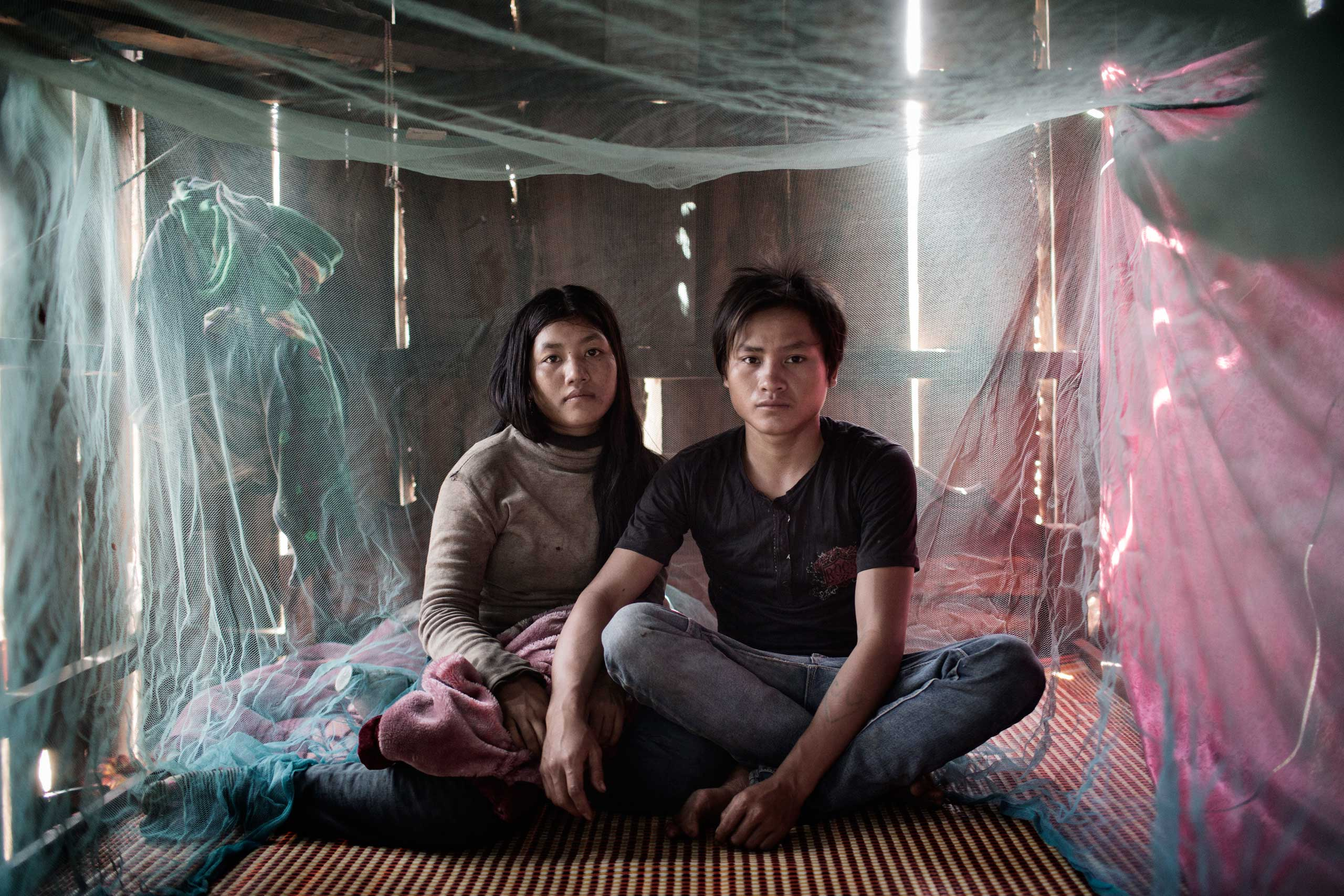 Al Jazeera America: Cambodia's Child GroomsKhien, 17, left, and her husband Kleng, 19, at their home in Nhang Commune. They are technically not married but live together with the consent of the community. They plan to wed when they can afford the ceremony.