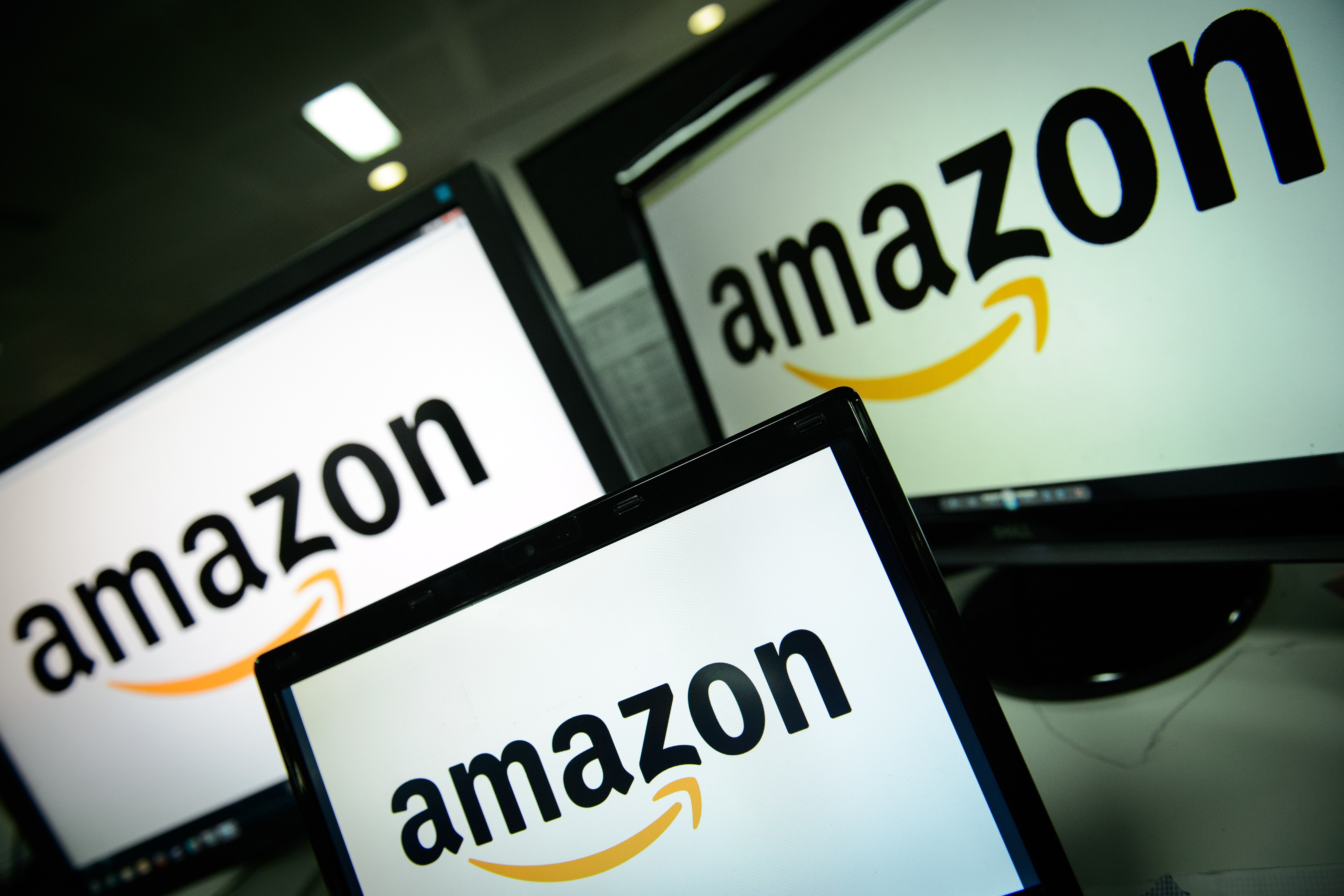 A picture shows the logo of the online retailer Amazon dispalyed on computer screens in London on Dec.11, 2014.
