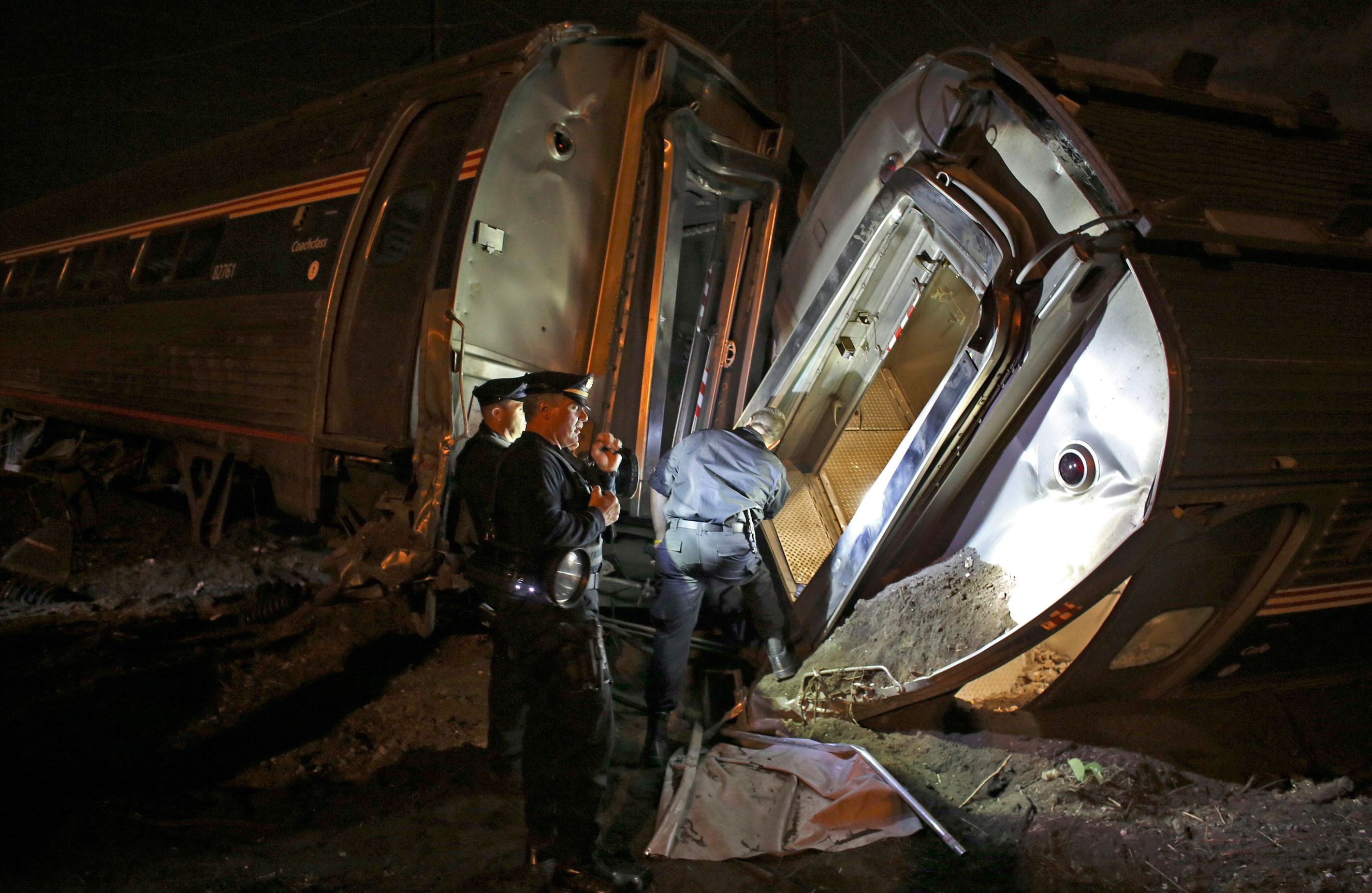 Emergency personnel work the scene of the Amtrak train wreck on May 12, 2015 in Philadelphia.