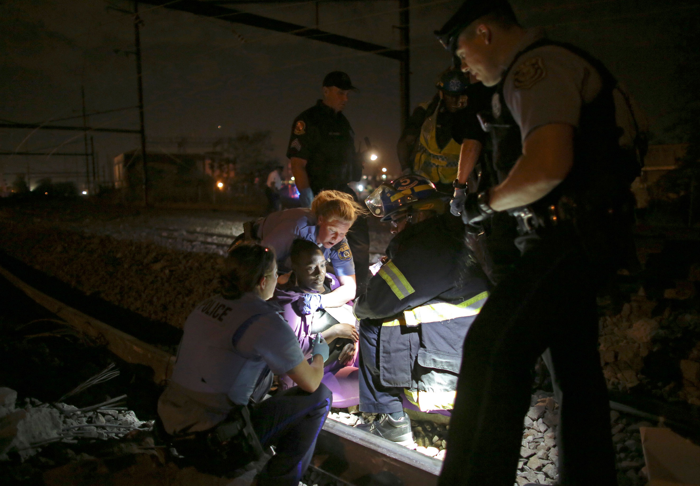 Emergency personnel work the scene of a train wreck on May 12, 2015, in Philadelphia.