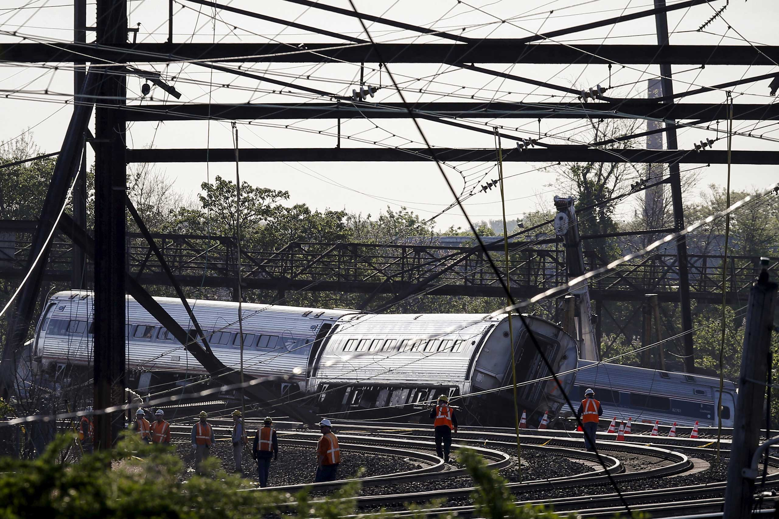 Officials survey the site of a derailed Amtrak train in Philadelphia on May 13, 2015.