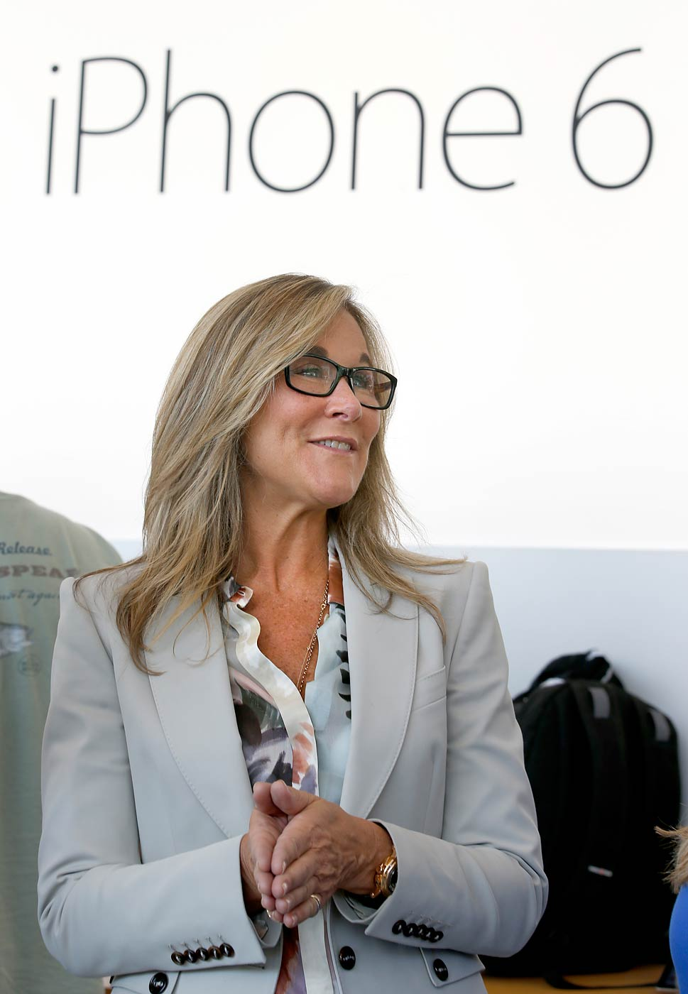 Angela Ahrendts, senior vice president of retail and online stores at Apple Inc., walks through the Apple Store during the launch and sale of the new iPhone 6 on Sept 19, 2014, in Palo Alto, Calif.
