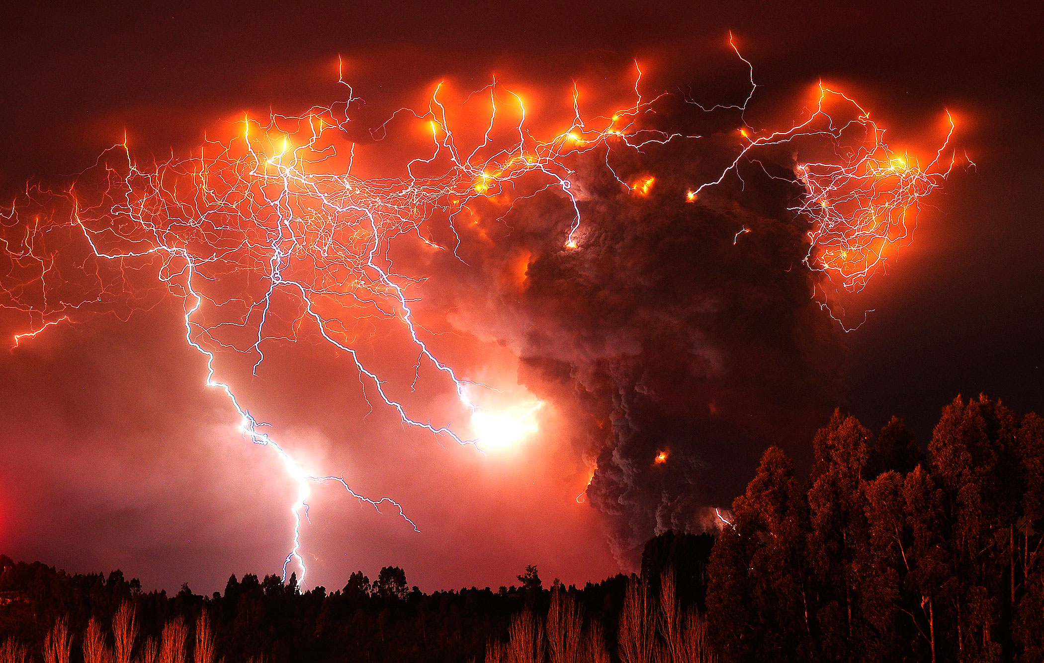Lightning strikes over the Puyehue volcano, over 500 miles south of Santiago, Chile, June 6, 2011.