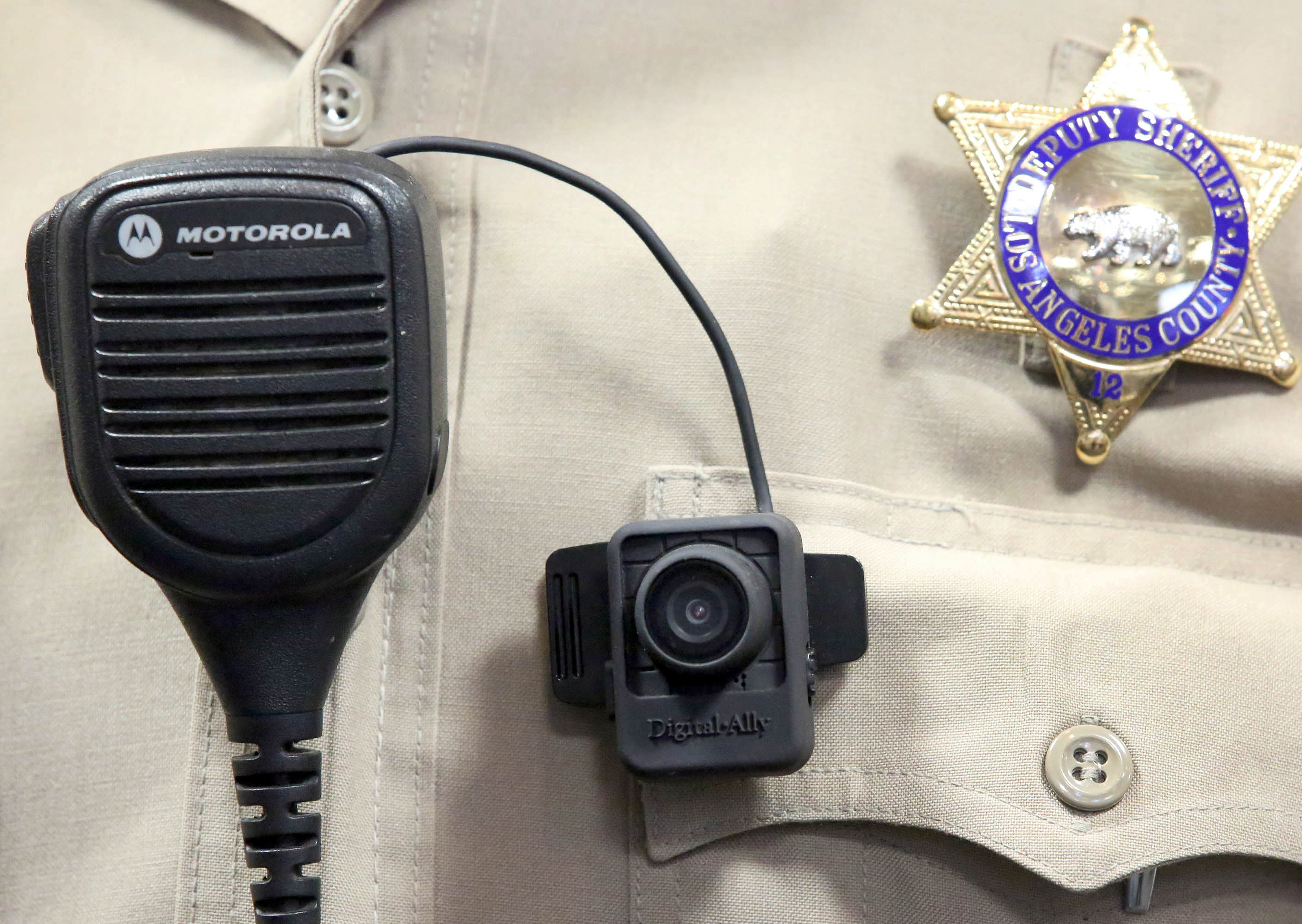 A body camera is displayed at a news conference at the Sheriff's Headquarters in the Monterey Park section of Los Angeles on Sept. 22, 2014.