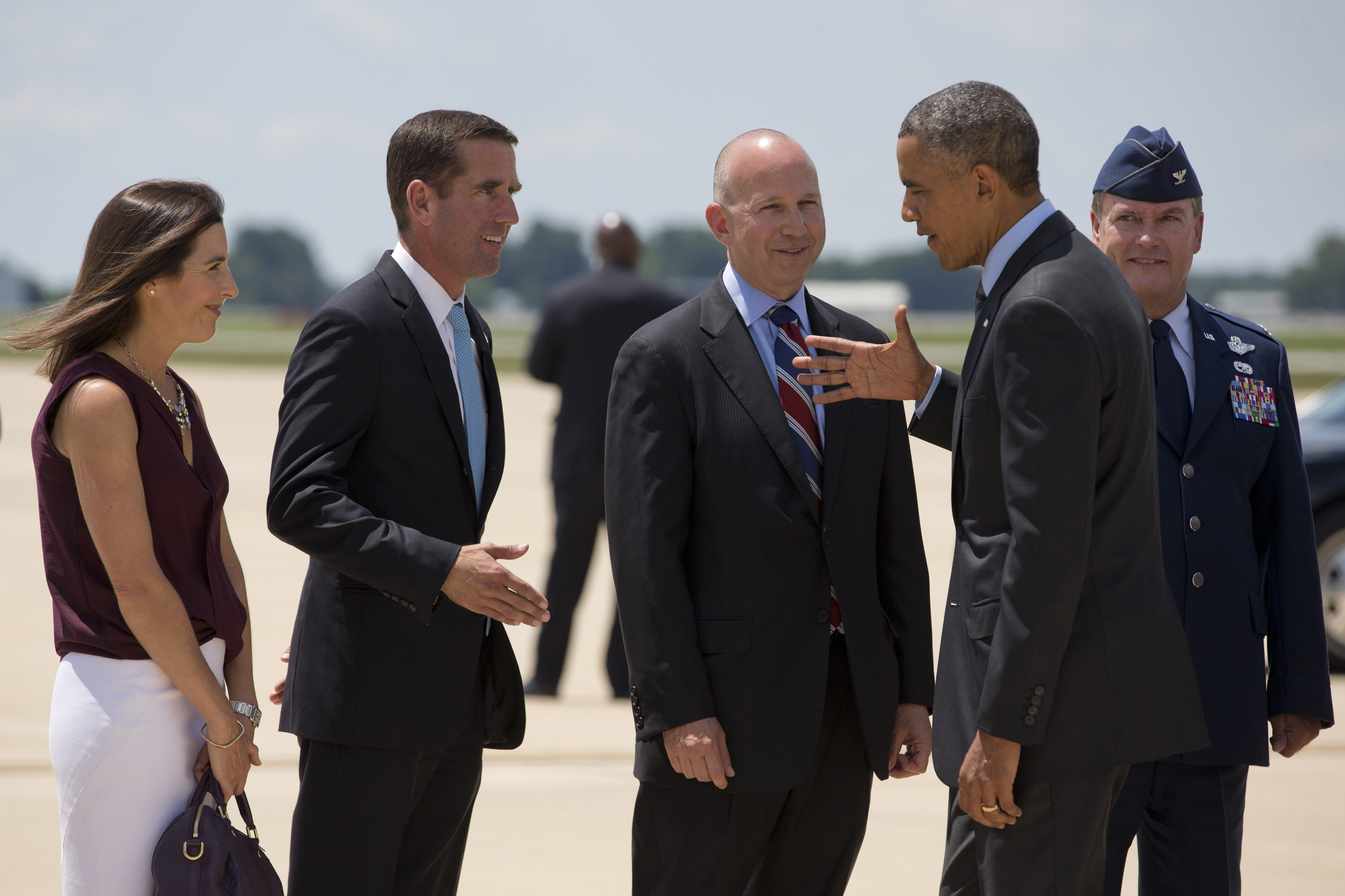 President Barack Obama shakes hands with Delaware Attorney General Beau Biden, left, next to Biden's wife, Hallie Biden, far left, and Delaware Governor Jack Markell as he arrives at New Castle Air National Guard Base in New Castle, Del., on July 17, 2014.