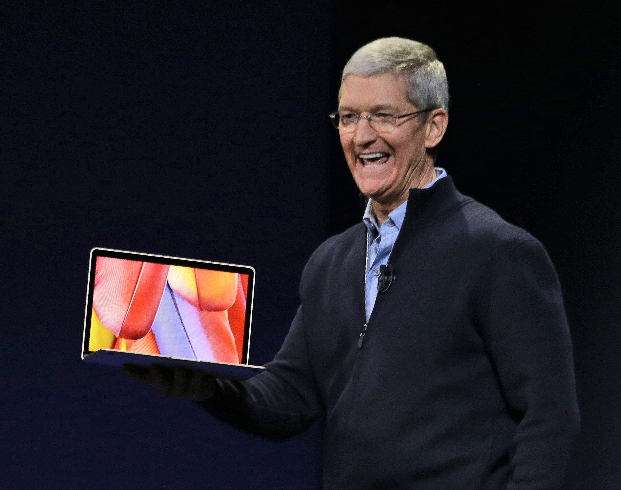 Apple CEO Tim Cook introduces the new Apple MacBook during an Apple event on Monday, March 9, 2015, in San Francisco.