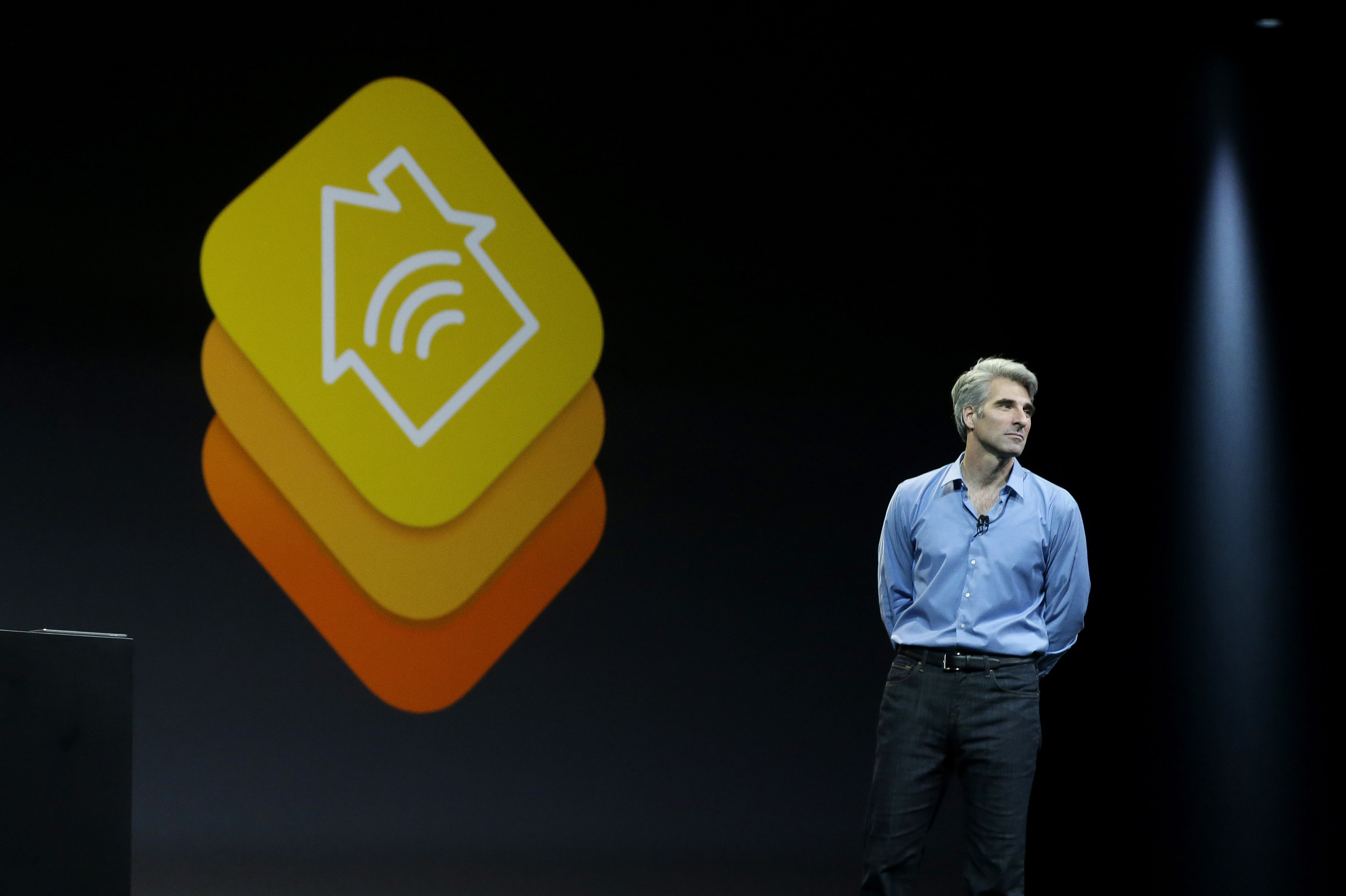 Apple senior vice president of Software Engineering Craig Federighi speaks about the Apple HomeKit app at the Apple Worldwide Developers Conference in San Francisco, Monday, June 2, 2014.