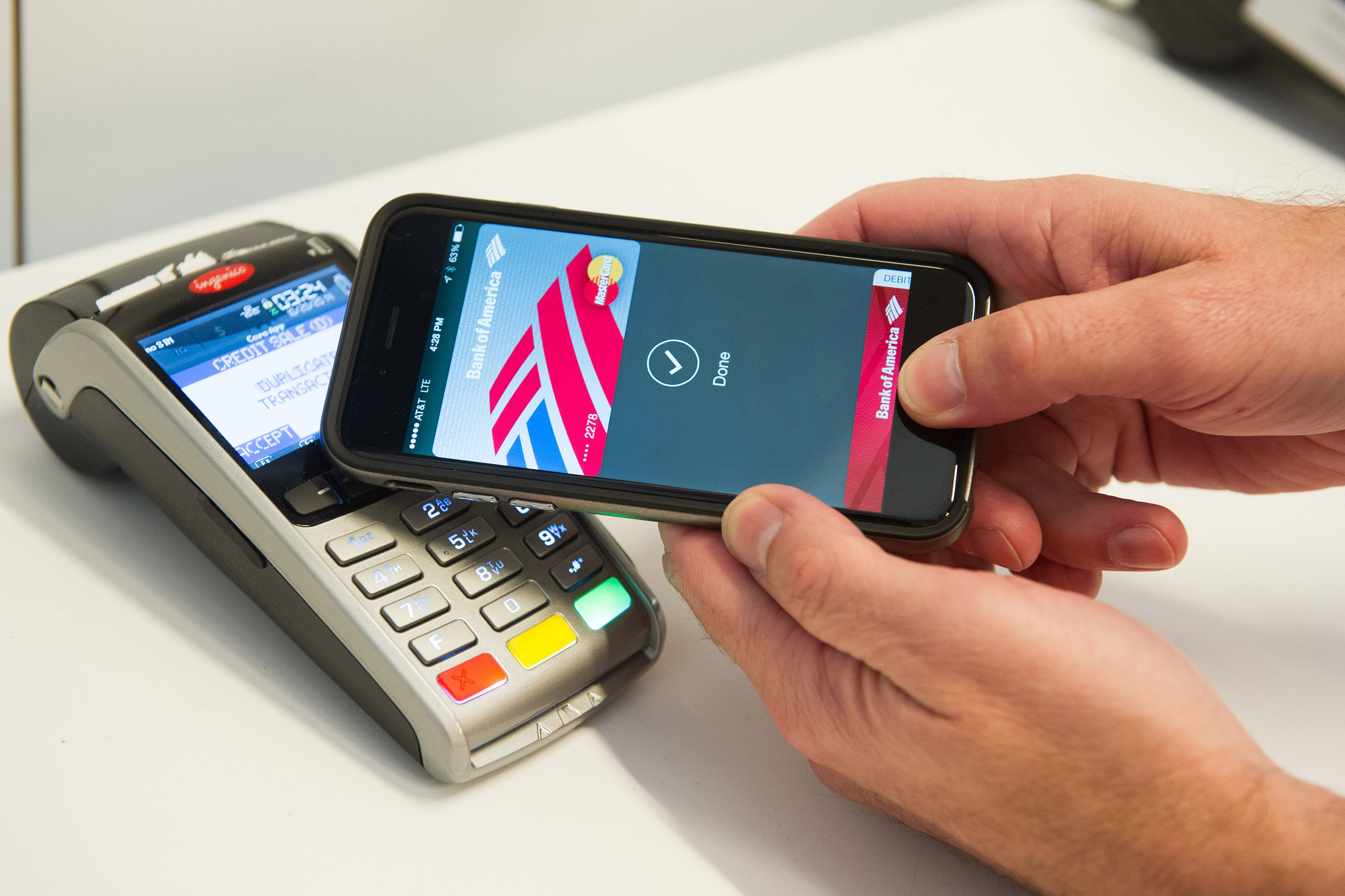 MasterCard demonstrates Apple Pay at the launch of MasterCard's NYC Tech Hub on Monday, Oct. 20, 2014 in New York.