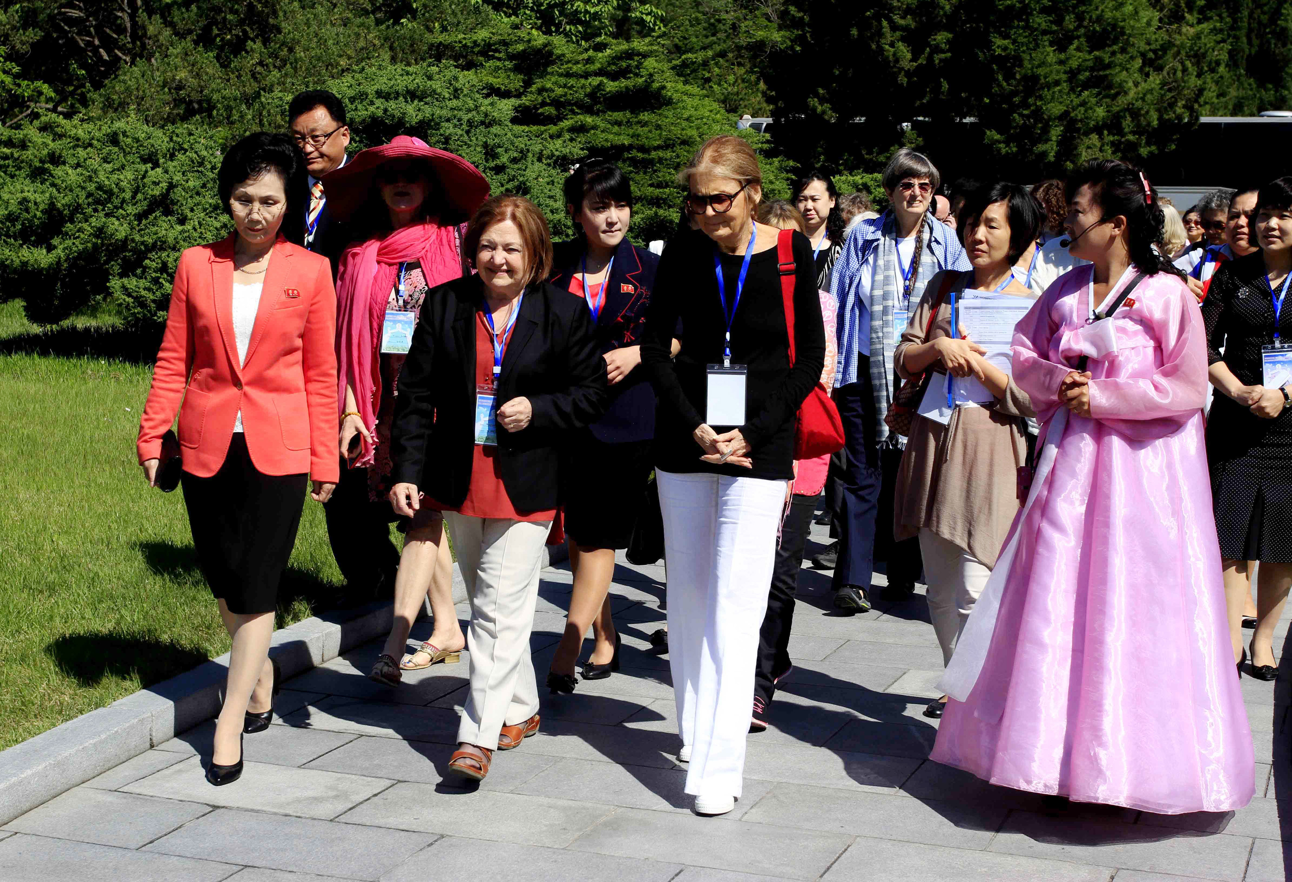 Activist Gloria Steinem, center right, and Nobel Peace Prize laureate Mairead Maguire, center left, along with other delegates, visit Mangyongdae, the birthplace of North Korea's late leader Kim Il Sung, in Pyongyang, Wednesday, May 20, 2015