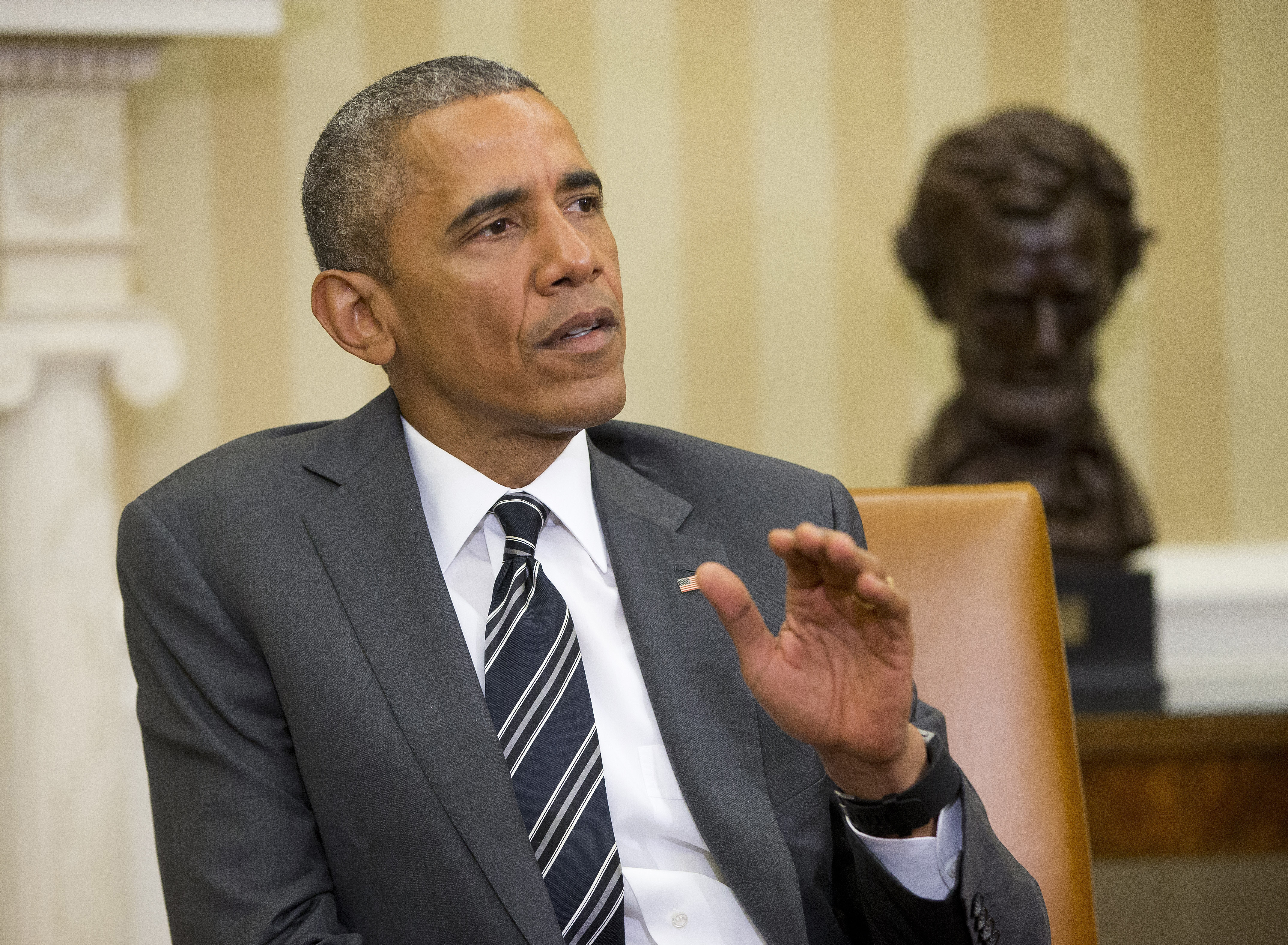 President Barack Obama speaks to members of the media during his meeting with NATO Secretary General Jens Stoltenberg, Tuesday, May 26, 2015, in the Oval Office of the White House in Washington.