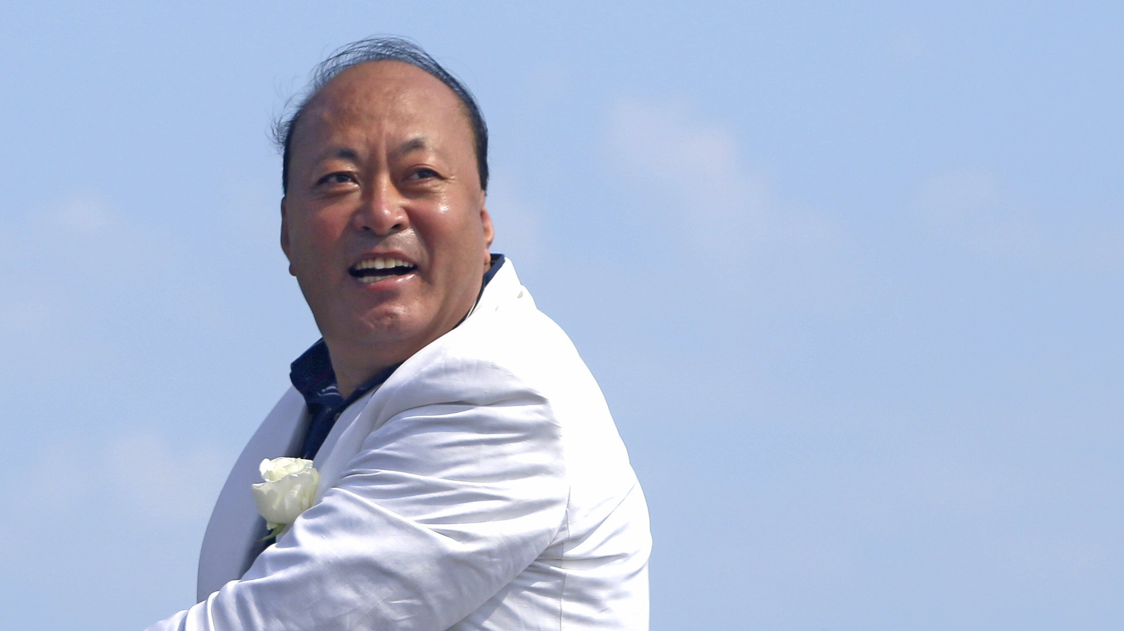 Tiens Group CEO Li Jinyuan poses during a parade on the Promenade des Anglais in Nice, southeastern France, on May 8, 2015